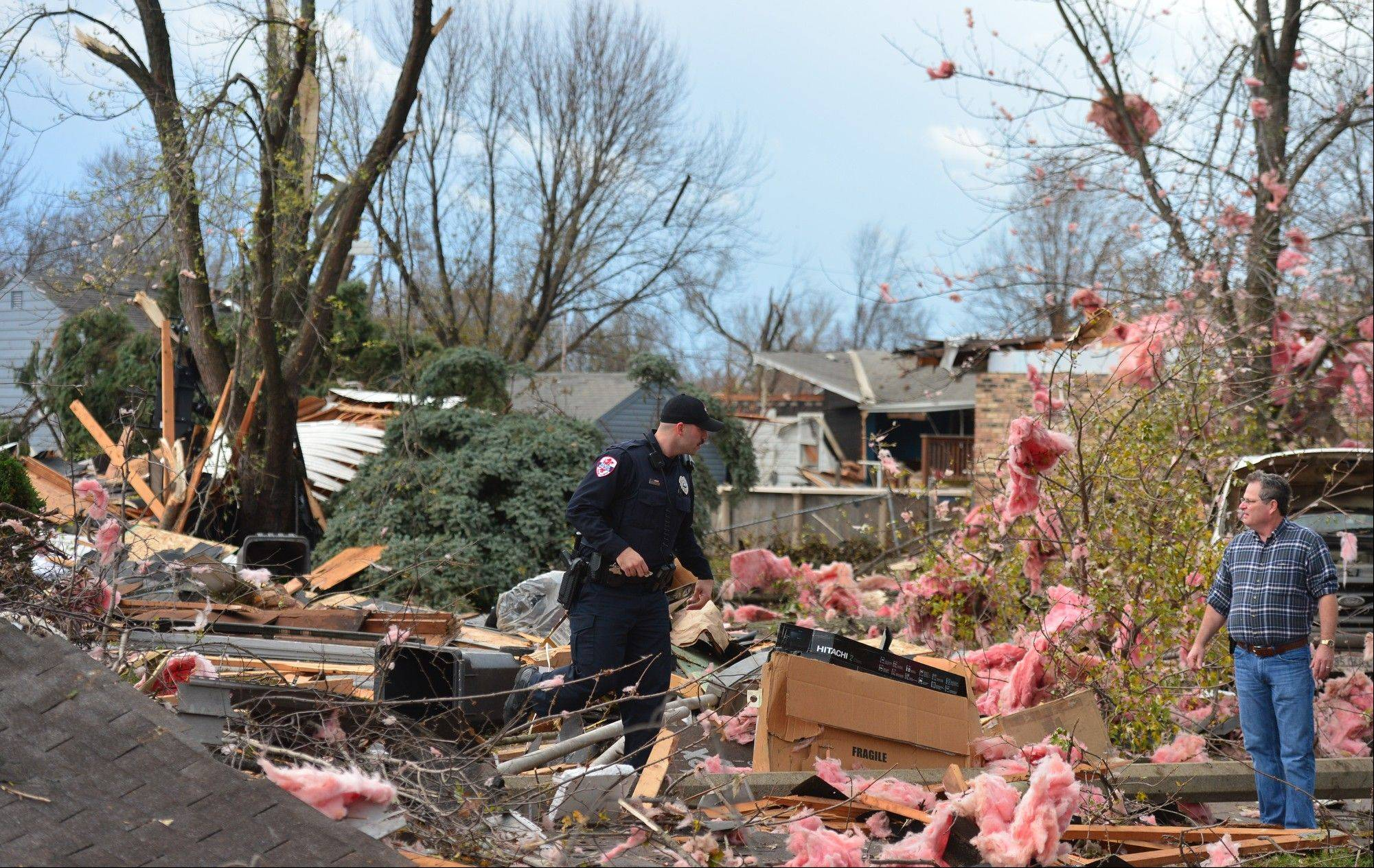 A tornado left a path of devastation through the north end of Pekin, Il.,Sunday, Nov. 17, 2013. Intense thunderstorms and tornadoes swept across the Midwest on Sunday, causing extensive damage in several central Illinois communities while sending people to their basements for shelter.