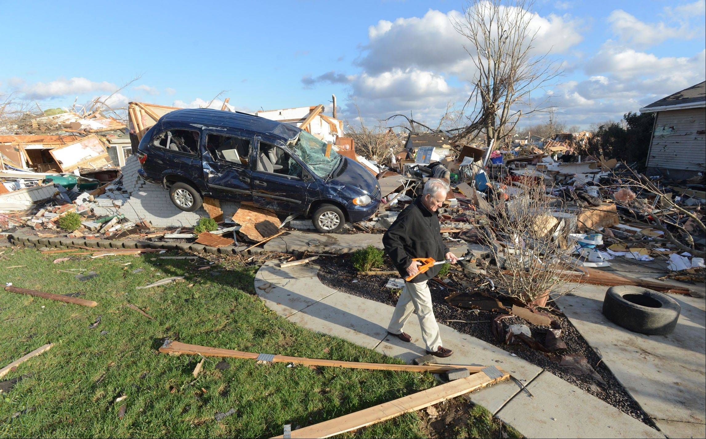 Richard Miller of Washington, Illinois salvages items from his brothers home, after a tornado leveled a subdivision on the North side of Washington, Ill., Sunday, Nov. 17, 2013. Intense thunderstorms and tornadoes swept across the Midwest, causing extensive damage in several central Illinois communities while sending people to their basements for shelter.
