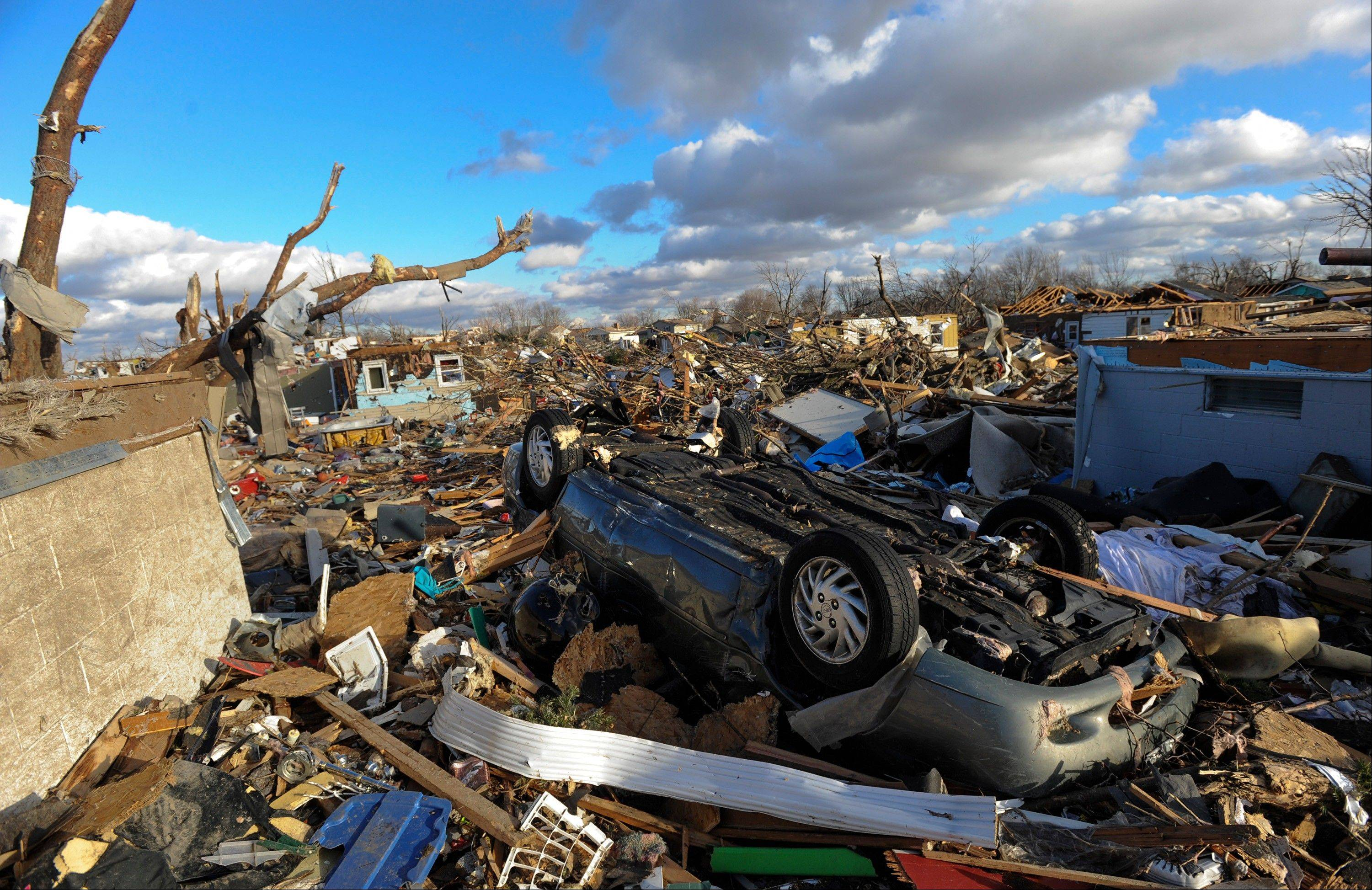 A neighborhood in the Devonshire subdivision of Washington, Ill., is left in ruins after a tornado tore through the northern part of the town on Sunday, Nov. 17, 2013.