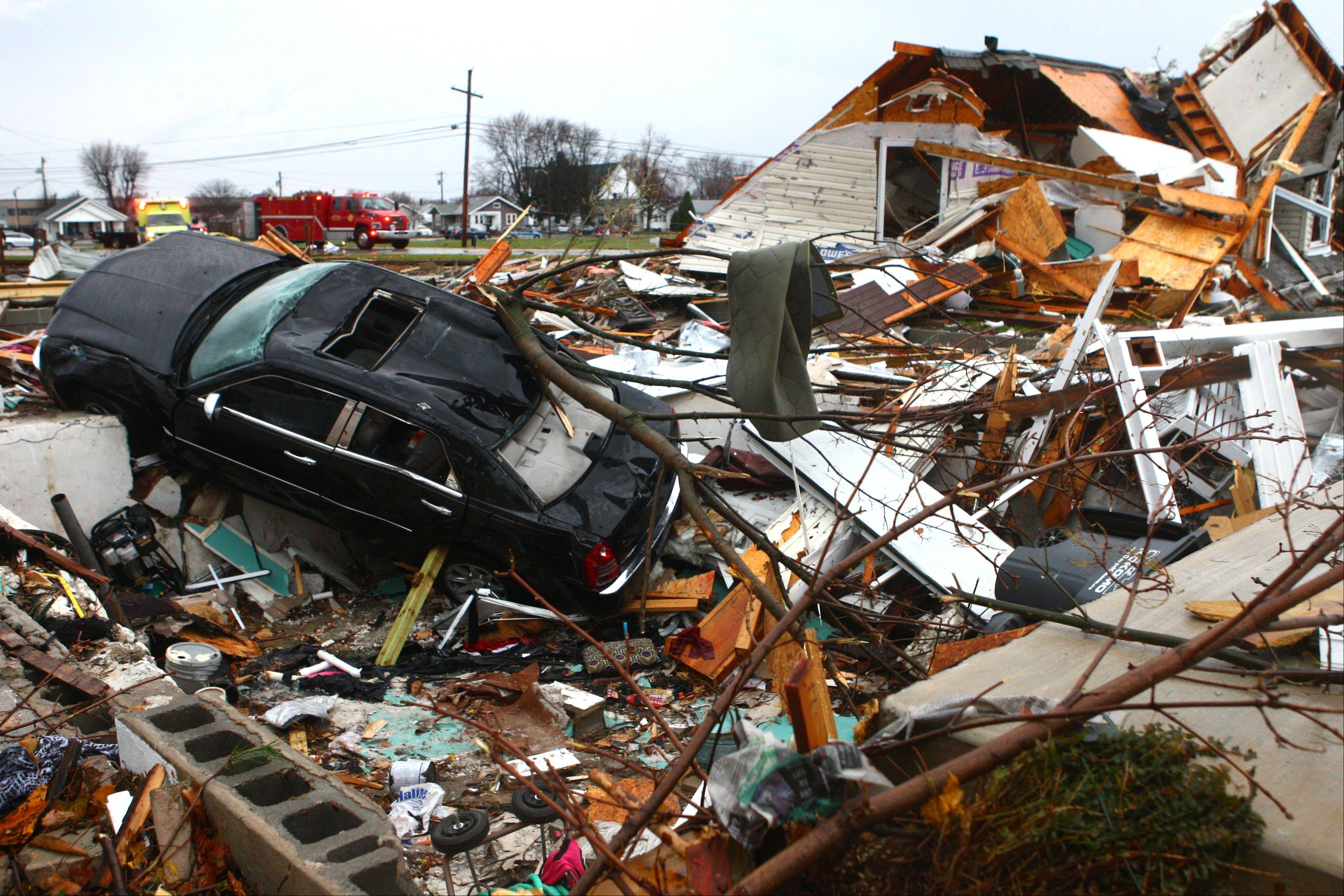 A car sits halfway in a basement at a leveled home near Home Avenue and Hoffer Street in Kokomo Sunday, Nov. 17, 2013.