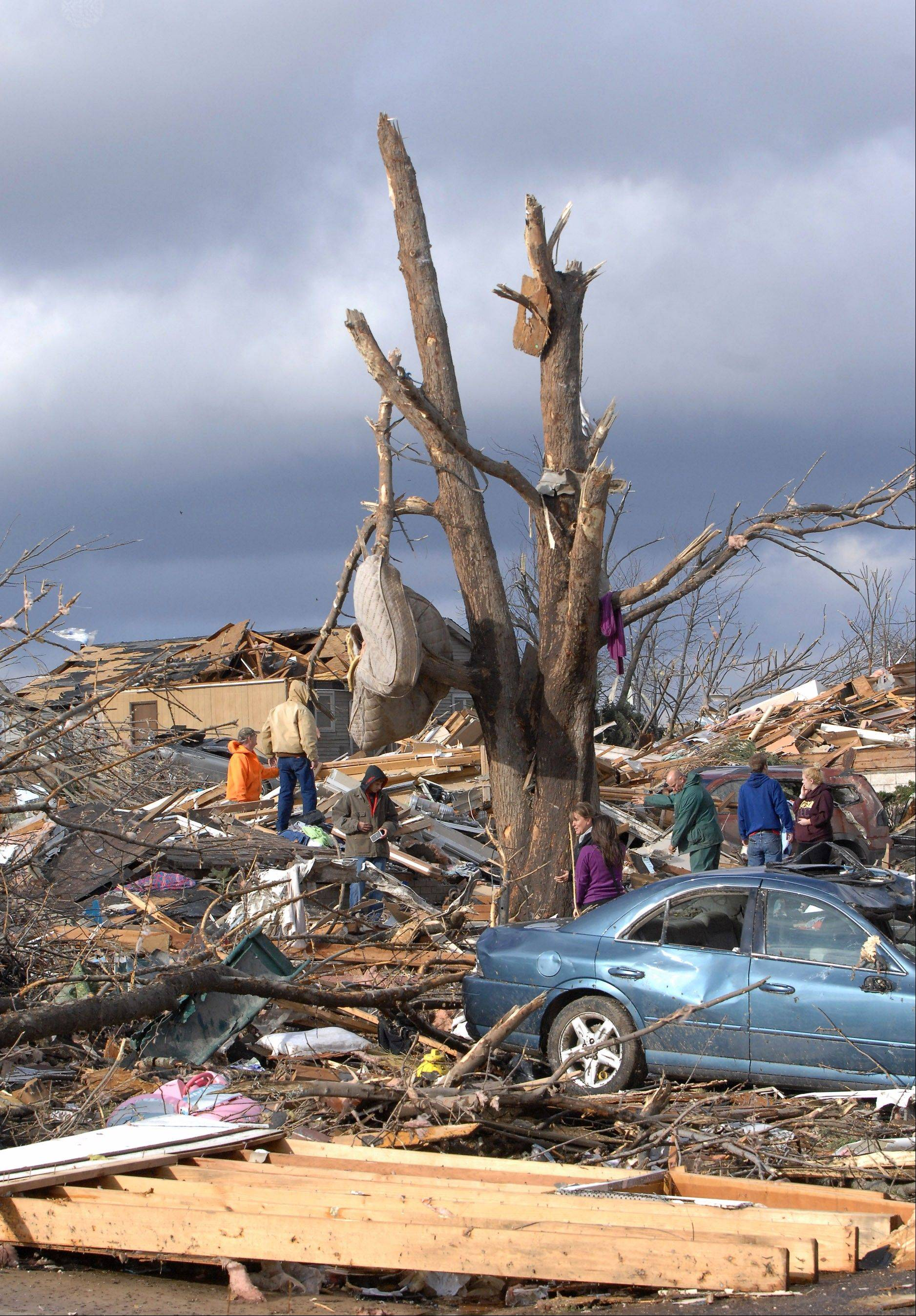 A mattress is wrapped around a stripped tree in Washington, Ill., Sunday, Nov. 17, 2013. Intense thunderstorms and tornadoes swept across the Midwest, causing extensive damage in several central Illinois communities while sending people to their basements for shelter.