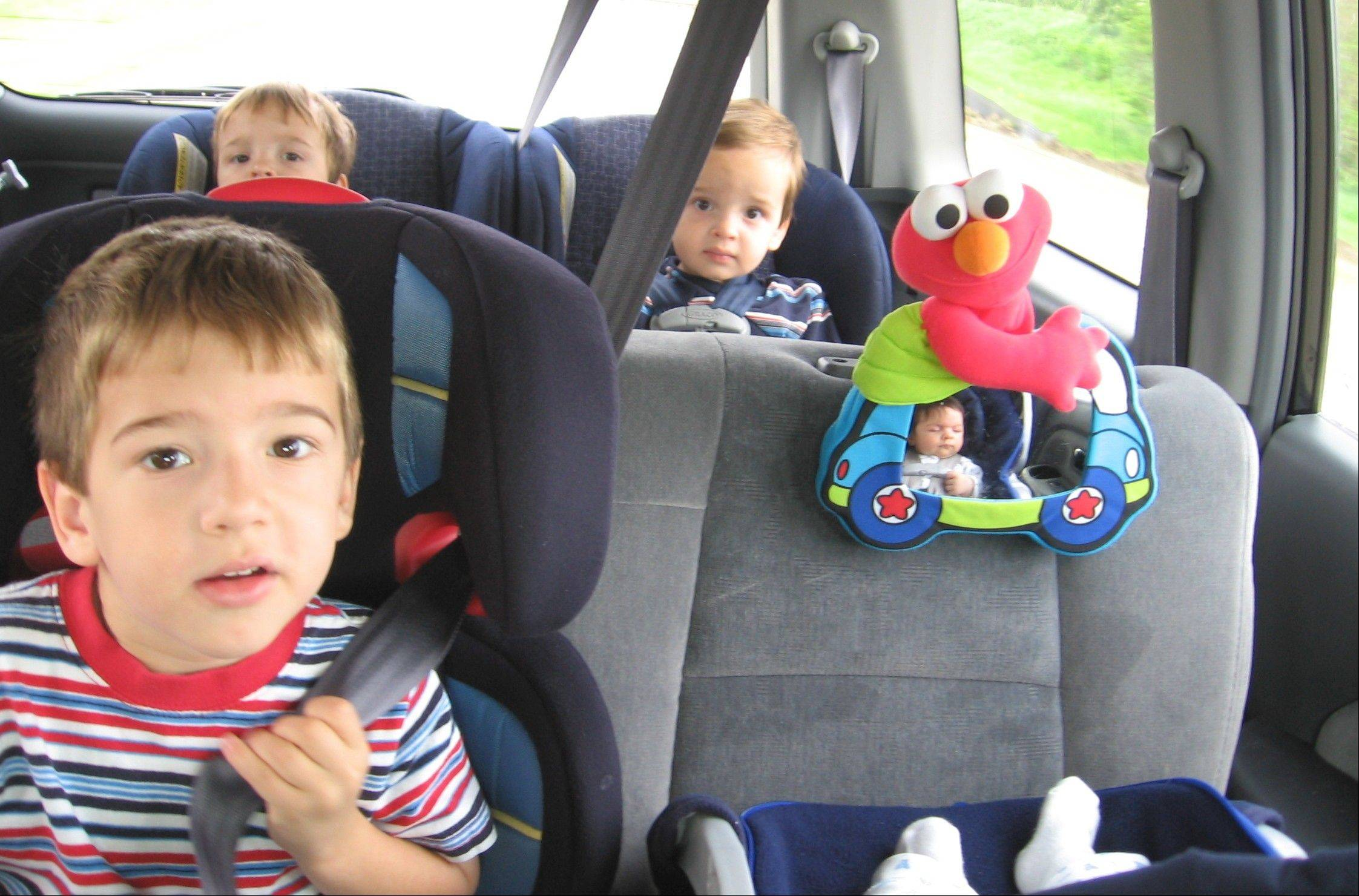 The Flais kids, including 2-year-old twins (rear), a 4-year-old and 2-month-old infant, hit the road in 2006. Family road trips can be