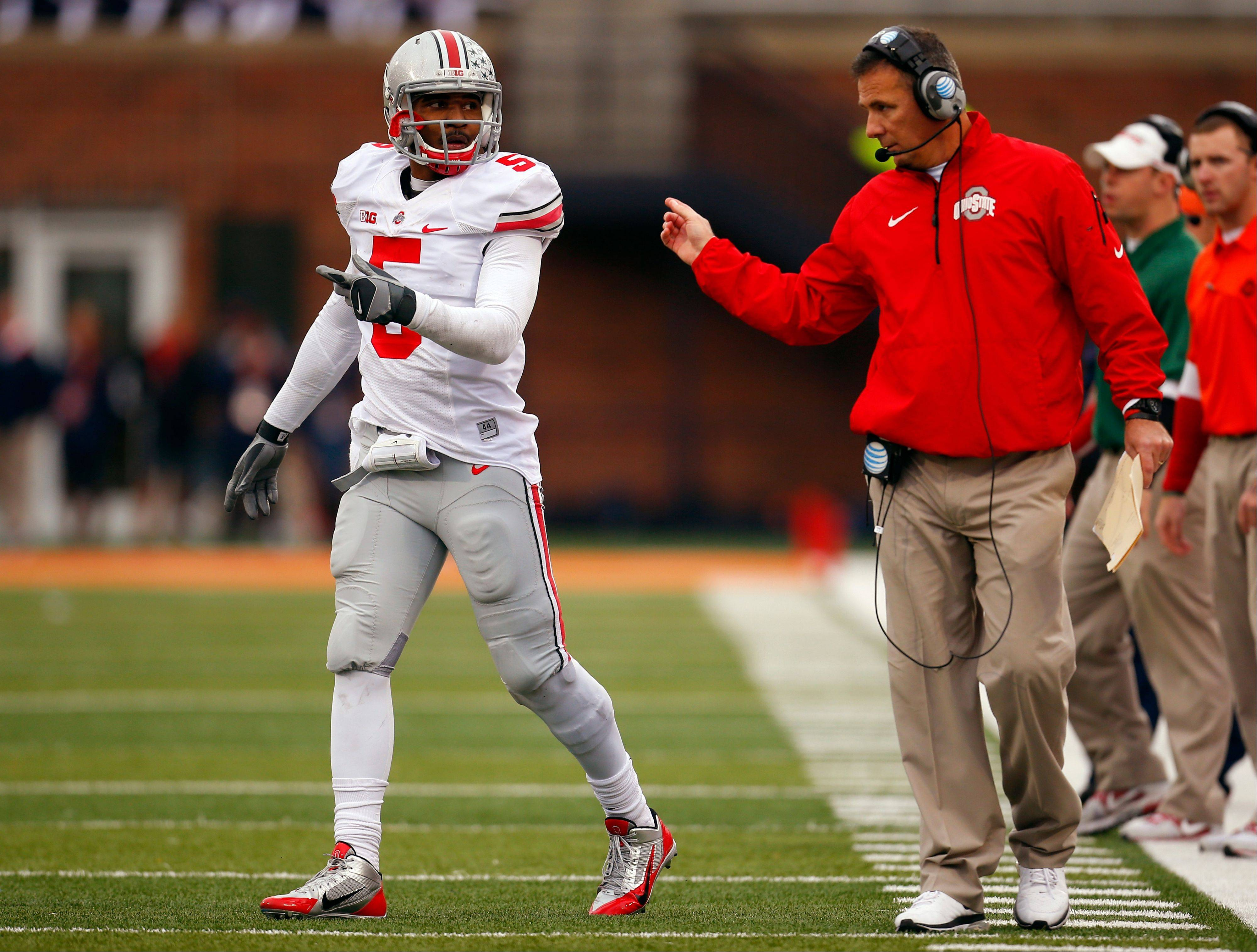 Ohio State head coach Urban Meyer talks with his quarterback Braxton Miller during the second half of Saturday's road win over Illinois. The Buckeyes have won a nation's best 22 games in a row but are ranked a distant No. 3 in the latest BCS ranking.