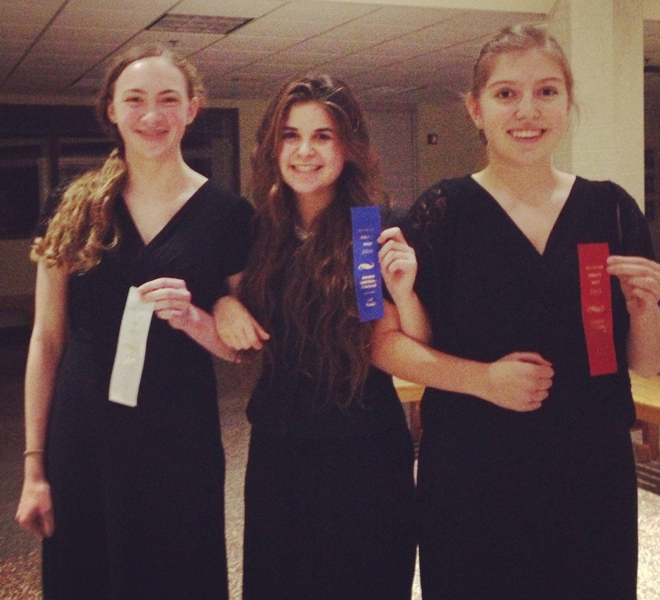 Woodlands Academy of the Sacred Heart sophomores Ellie Randolph of Lake Forest, Arminda Downey-Mavromatis of Gurnee and Elena Gutierrez of Waukegan (left to right) combined for a perfect 12-0 record en route to 1st, 2nd and 3rd place honors in the Lincoln-Douglas Novice Division at the 2013 Munster Open Debate Tournament in Munster, Ind. In addition, Downey-Mavromatis was named the Novice Division Tournament Champion.