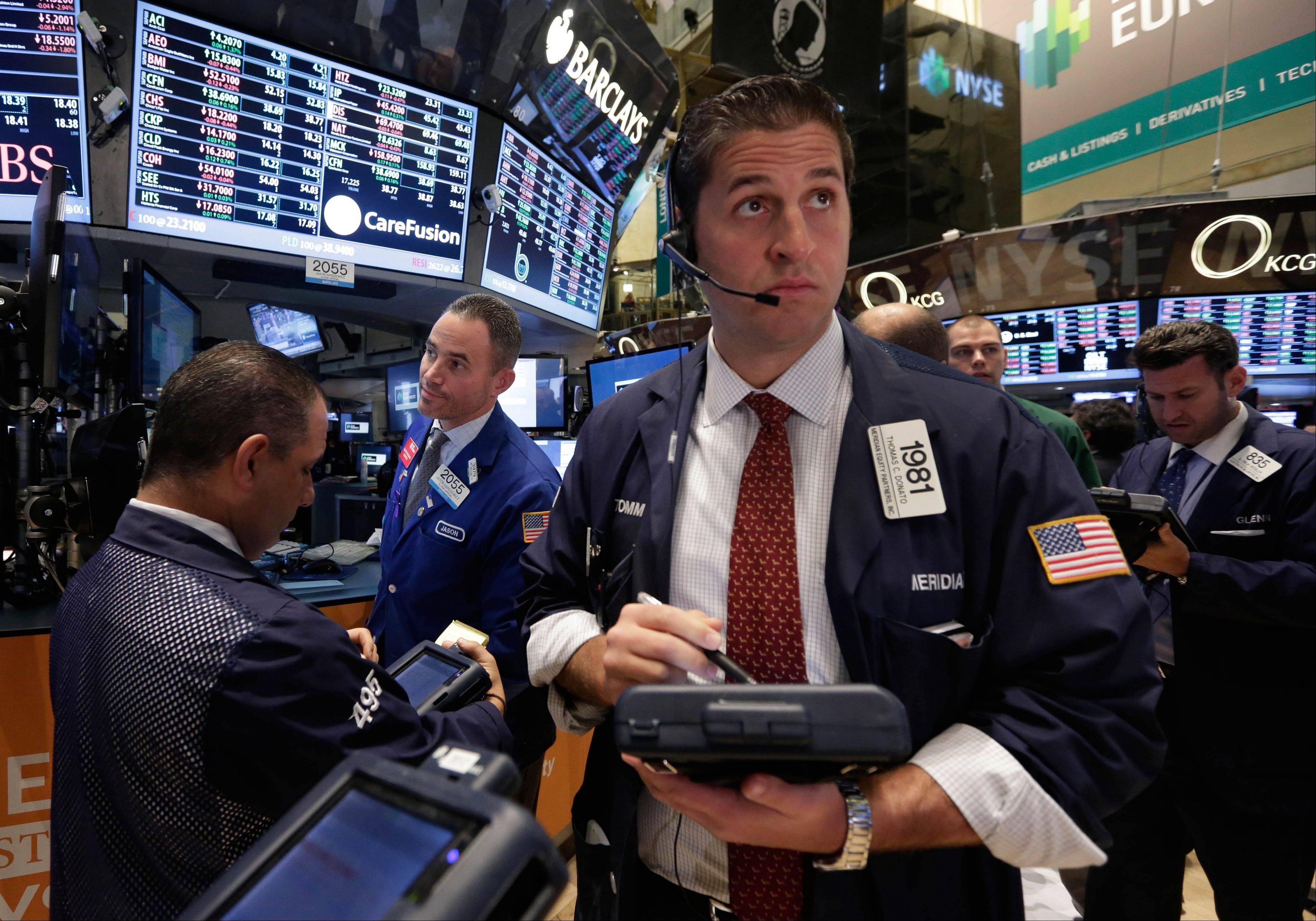 U.S. stocks fell after disappointing forecasts from Best Buy Co. and Campbell Soup Co. while investors awaited a speech from Federal Reserve Chairman Ben S. Bernanke later Tuesday evening to gauge the prospect of continued stimulus.
