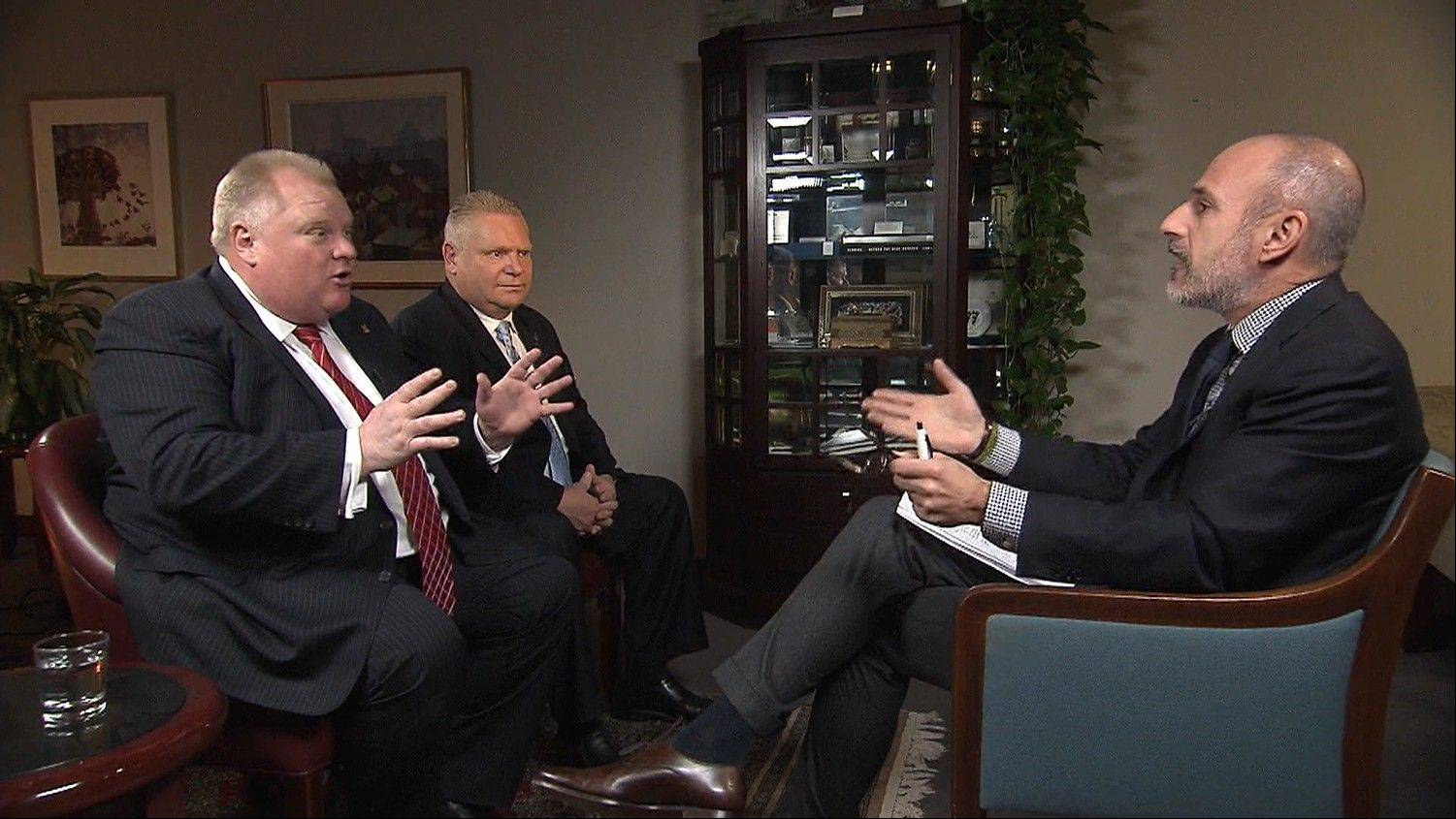 "Matt Lauer, right, speaking with Toronto Mayor Rob Ford, left, as the mayor's brother, City Councilor Doug Ford, looks on during an interview in Toronto for the ""Today"" show."
