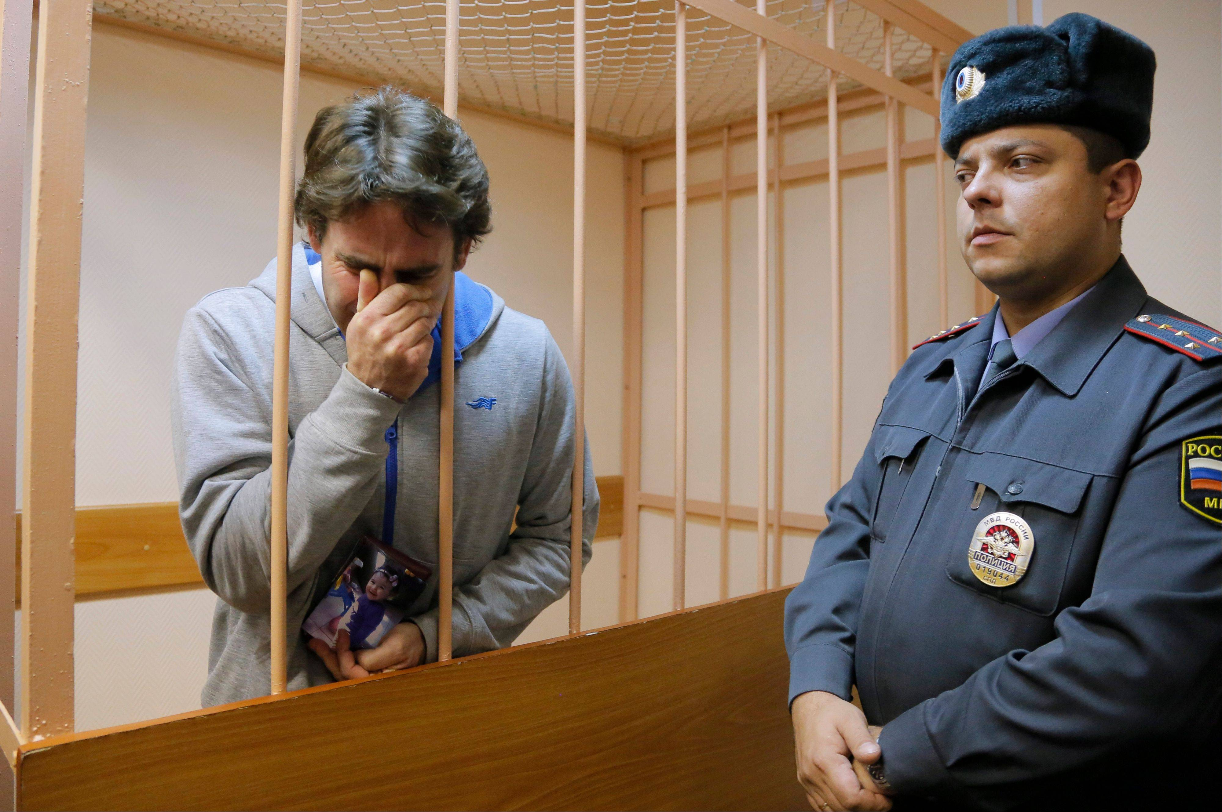 A Russian court on Tuesday granted bail to Greenpeace protesters from Argentina, Brazil, Canada, Italy, New Zealand and Poland, the first group of foreign activists eligible for release from jail while awaiting trial for participating in a demonstration near a Russian oil rig. Activist Miguel Hernan Perez Orsi of Argentina, left, reacts to the verdict.