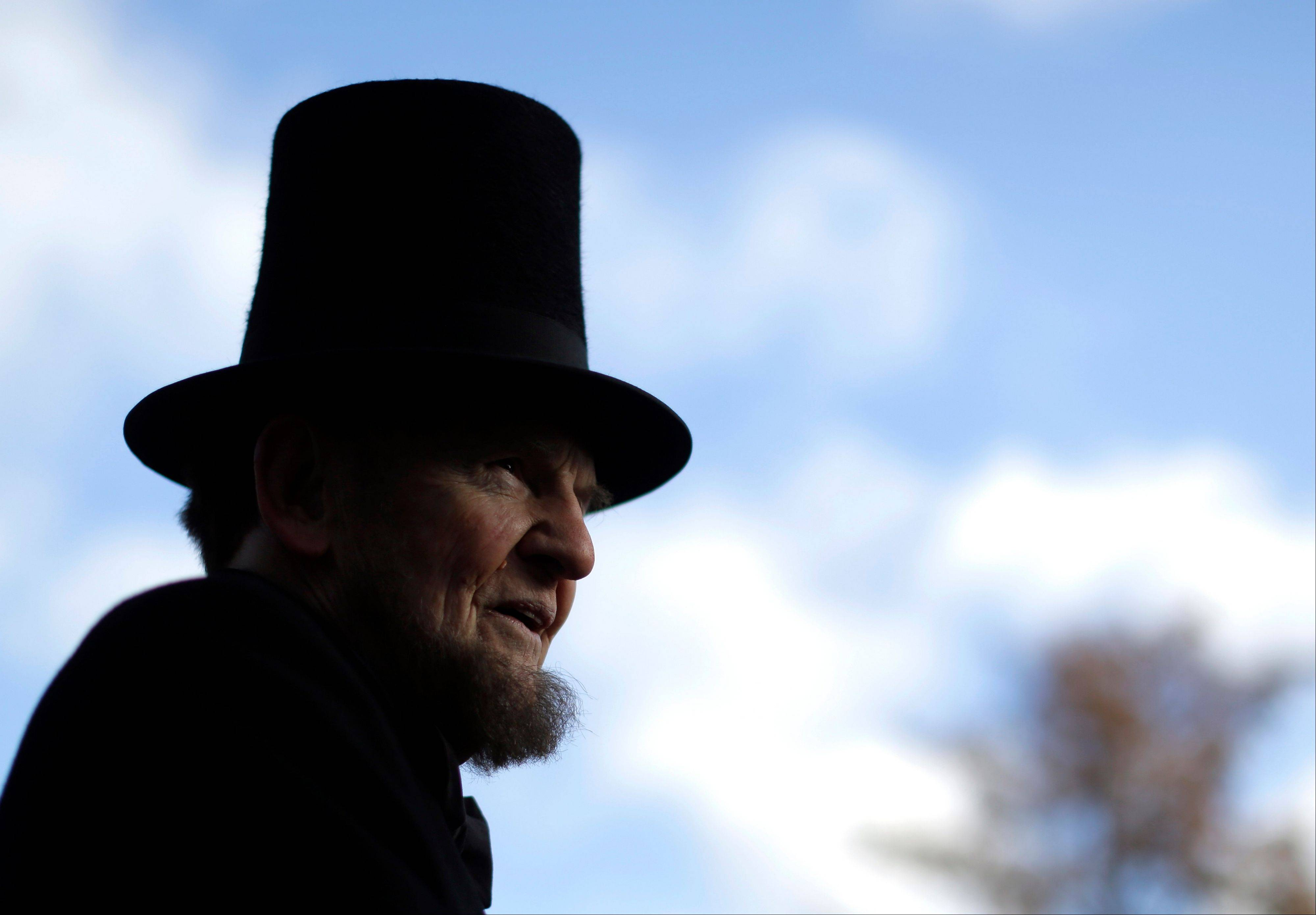 James Getty, portraying President Abraham Lincoln, pauses before a ceremony commemorating the 150th anniversary of the dedication of the Soldiers' National Cemetery and President Abraham Lincoln's Gettysburg Address, Tuesday Nov. 19, 2013, in Gettysburg, Pa.