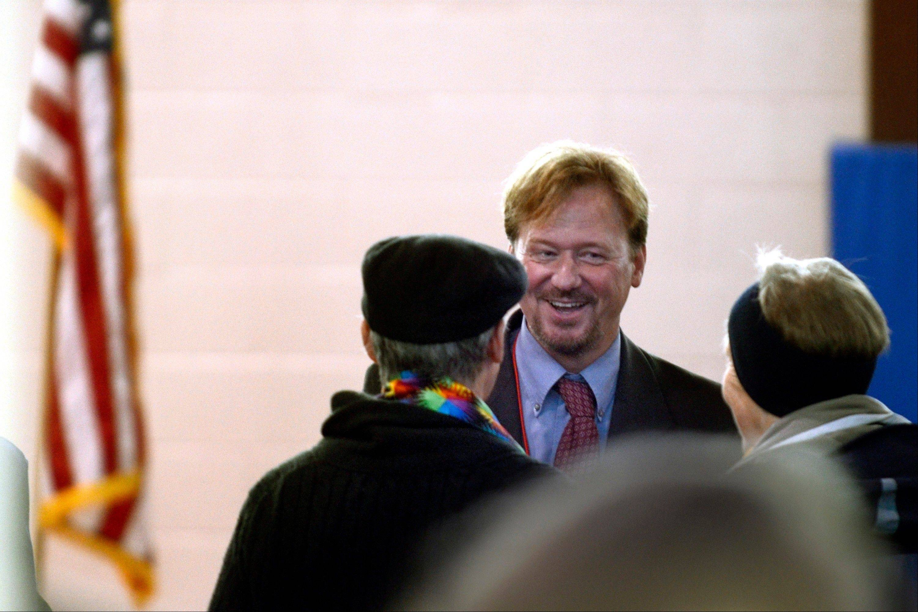 Rev. Frank Schaefer talks Monday inside the Rec. center as his trial breaks for lunch in Spring City, Pa. Schaefer could learn Tuesday if he'll be defrocked.