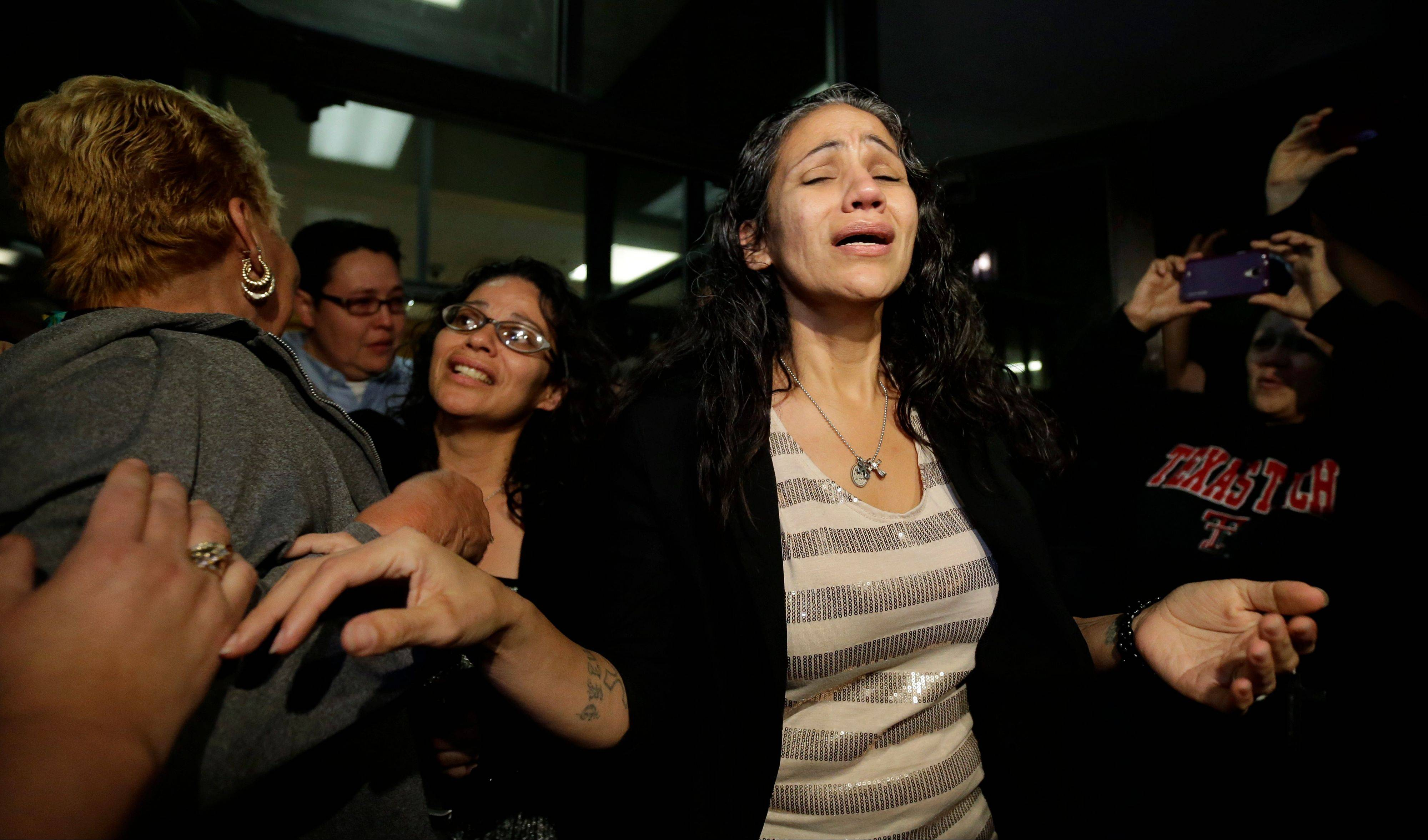 Cassandra Rivera, center, followed by Elizabeth Ramirez and Kristie Mayhugh are greeted by family Monday as they leave the Bexar County Jail in San Antonio. A judge decided to recommend that an appeals court vacate their 1998 convictions as tainted by faulty witness testimony.