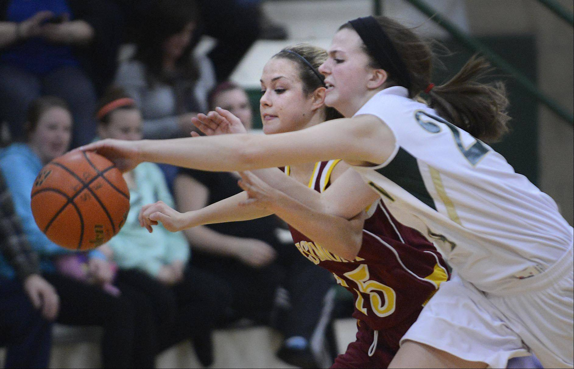 St. Edward's Katie Swanson stretches for the ball against Westmont's Annie Carlson Tuesday in Elgin.