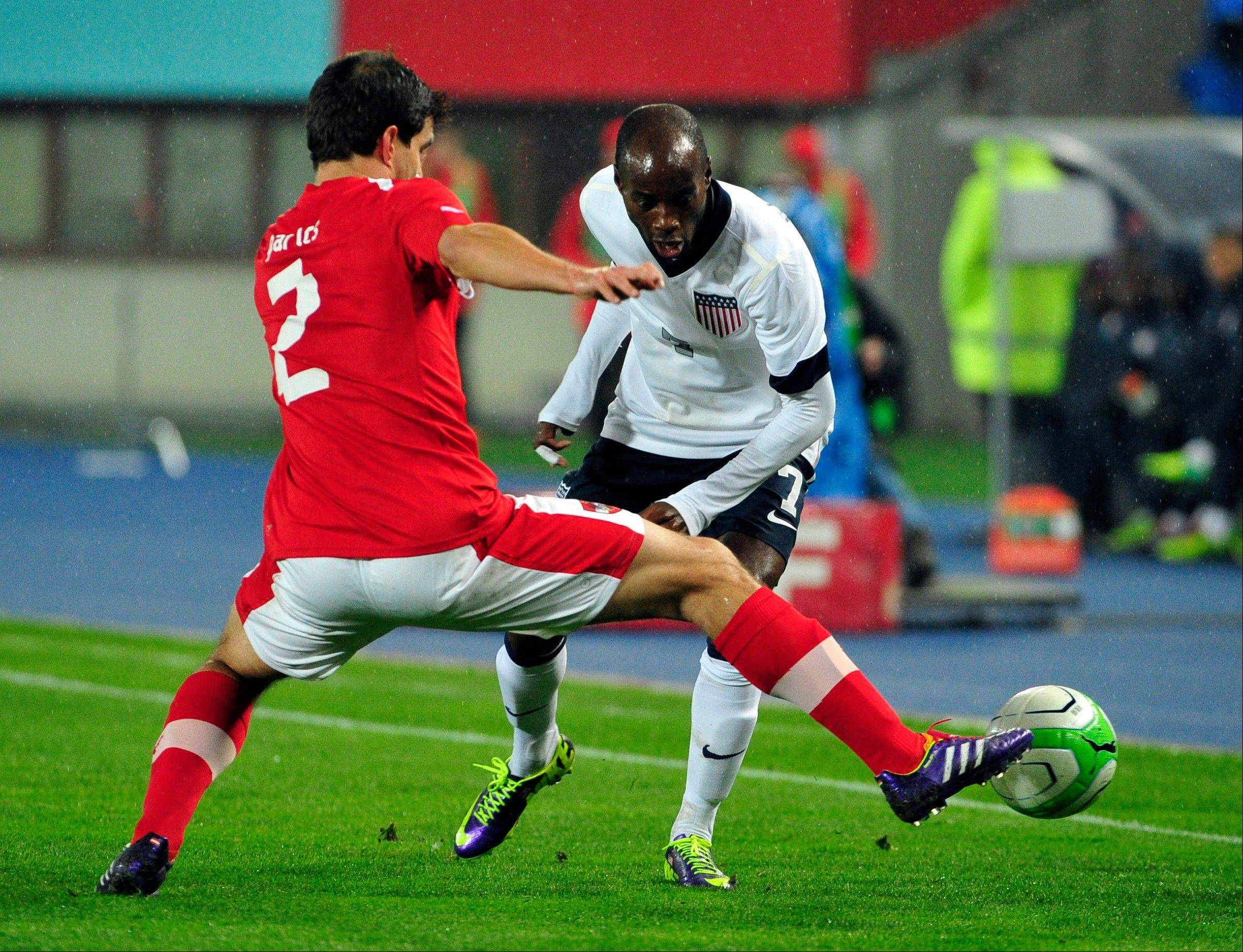 Austria's Gyoergy Garics, left, and DaMarcus Beasley of U.S. challenge for the ball during a friendly soccer match Tuesday in Vienna, Austria.