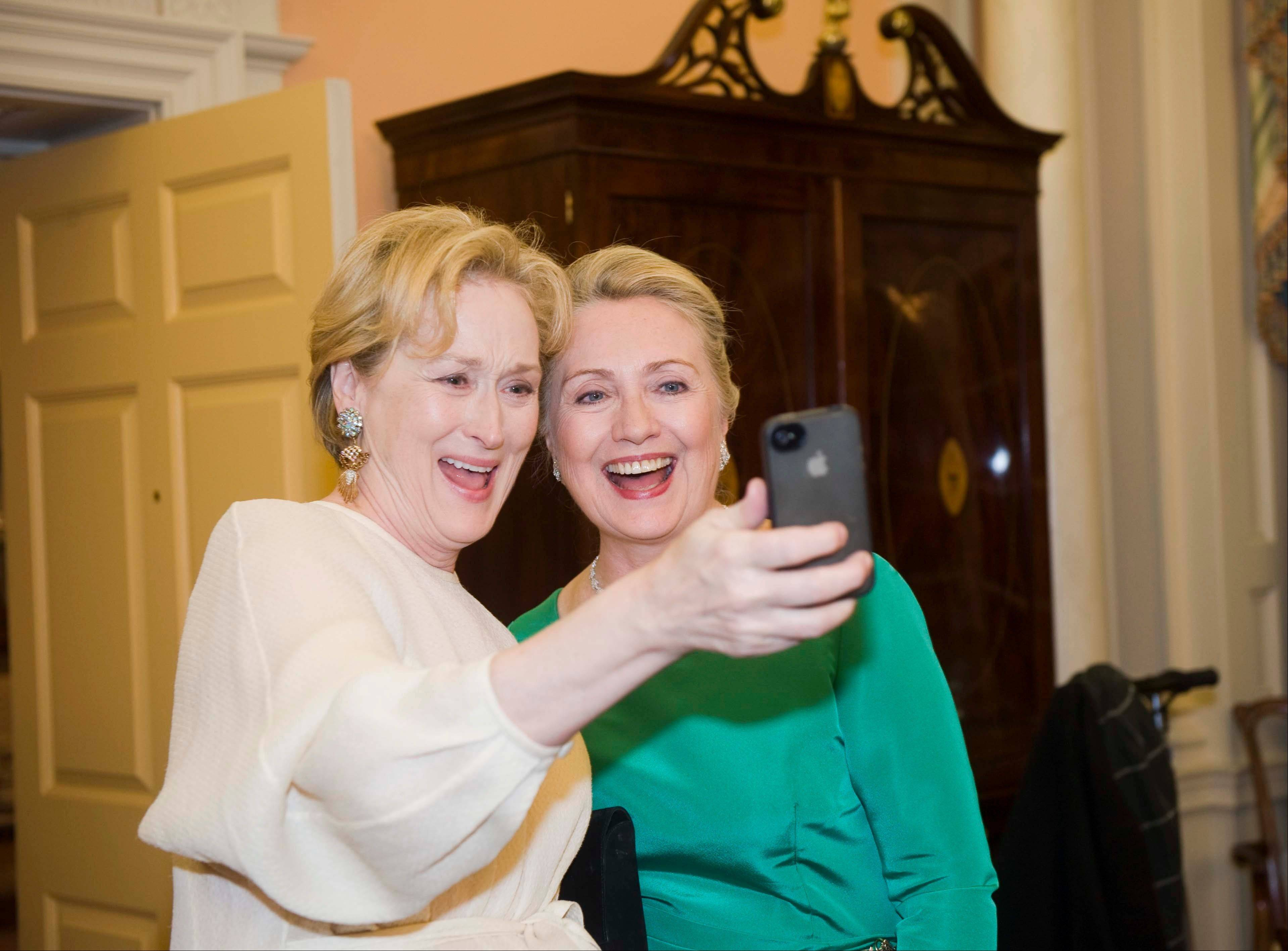 "Actress Meryl Streep uses her phone to take a photo of her and Secretary of State Hillary Rodham Clinton following the State Department Dinner for the Kennedy Center Honors gala at the State Department in Washington. ""Selfie"" the smartphone self-portrait has been declared word of the year for 2013 by Britain's Oxford University Press."