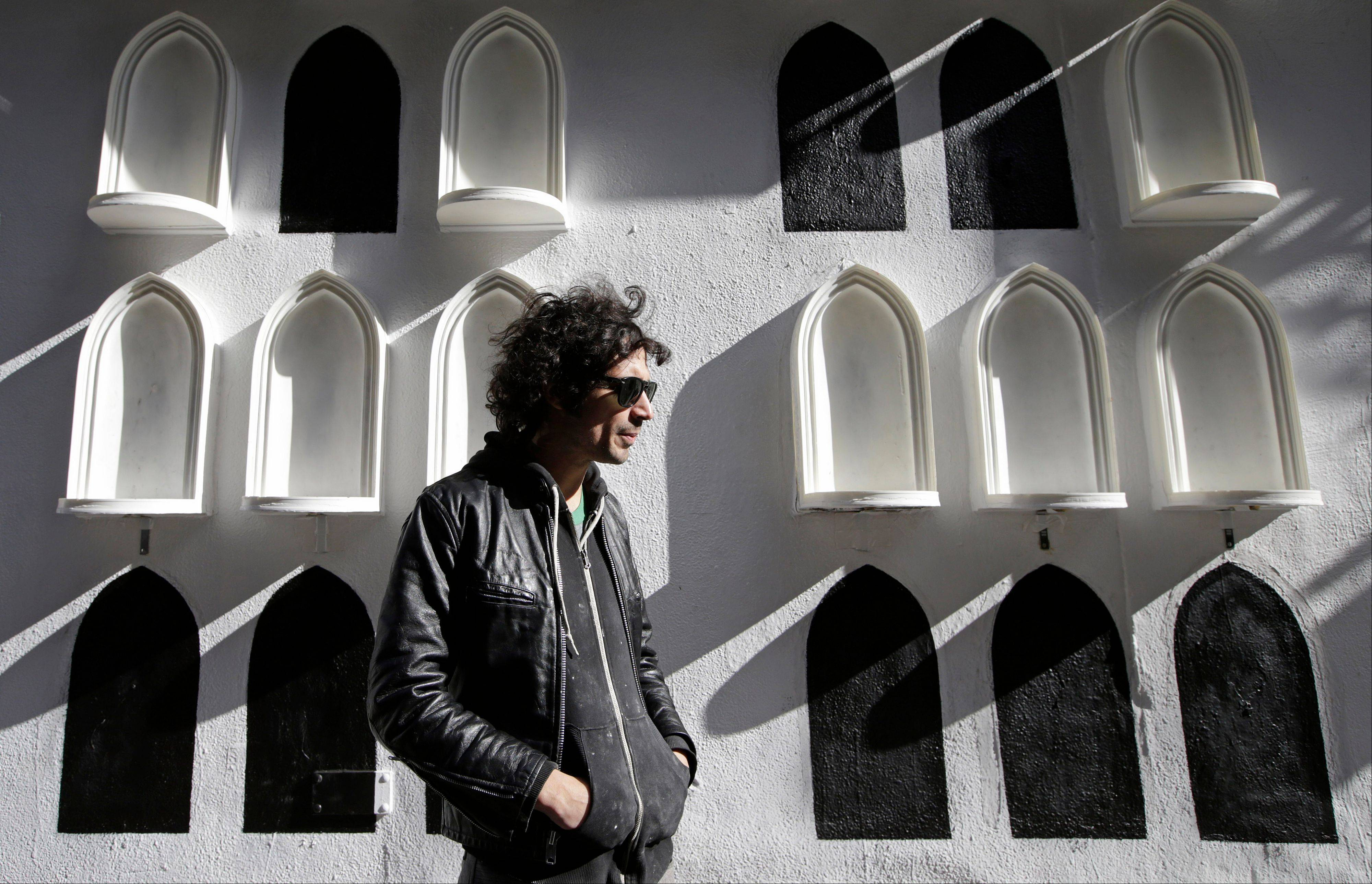 The Strokes' drummer Fabrizio Moretti in front of his installation on the exterior wall of the SoHo Rag & Bone store in New York. The installation is part of the clothing brand's ongoing urban art project, in which they get artists to revamp the store's facade.