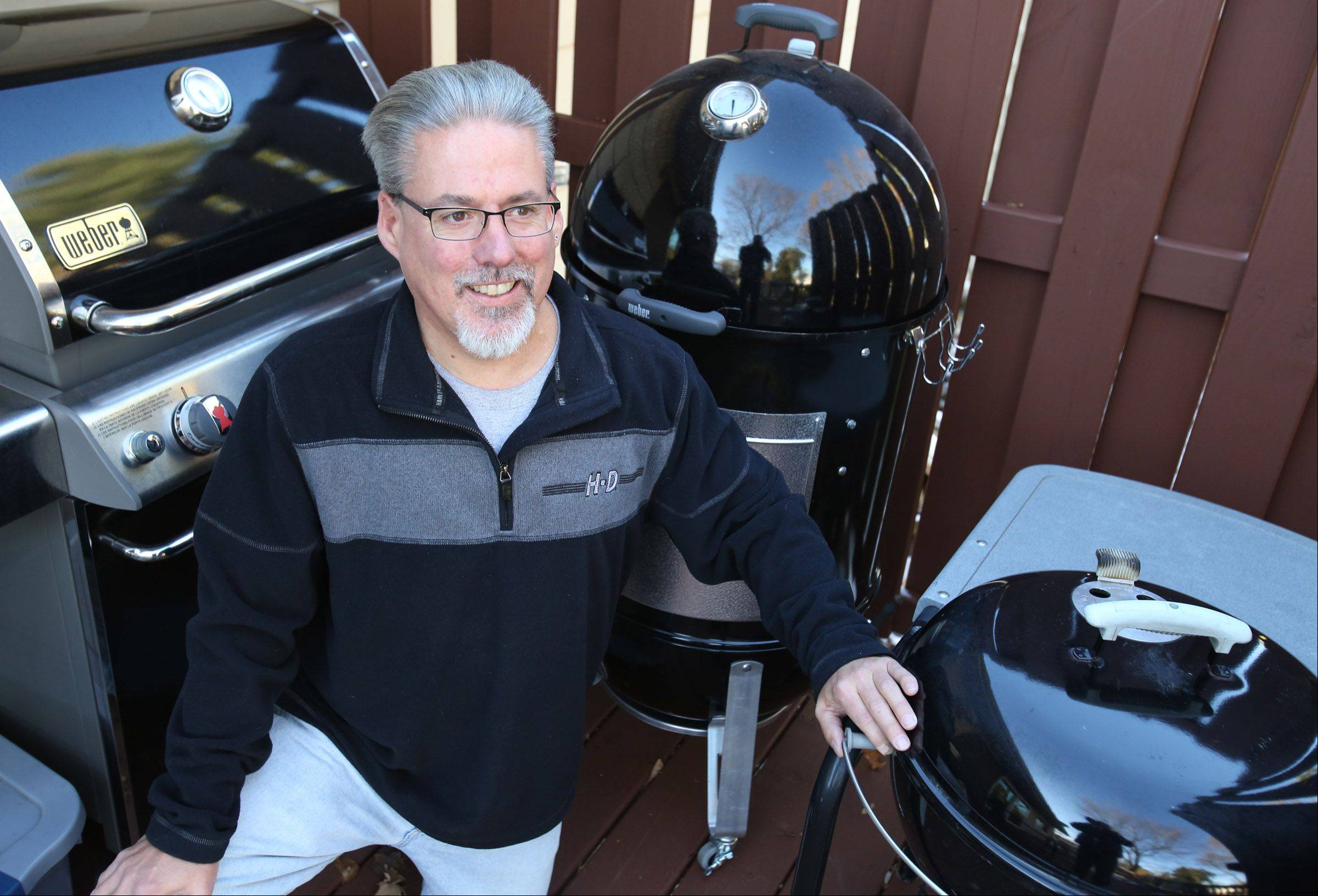 A little snow doesn't keep Kevin Thomas from firing up the grill or his smoker. He plans to prepare smoked turkey for Thanksgiving dinner.