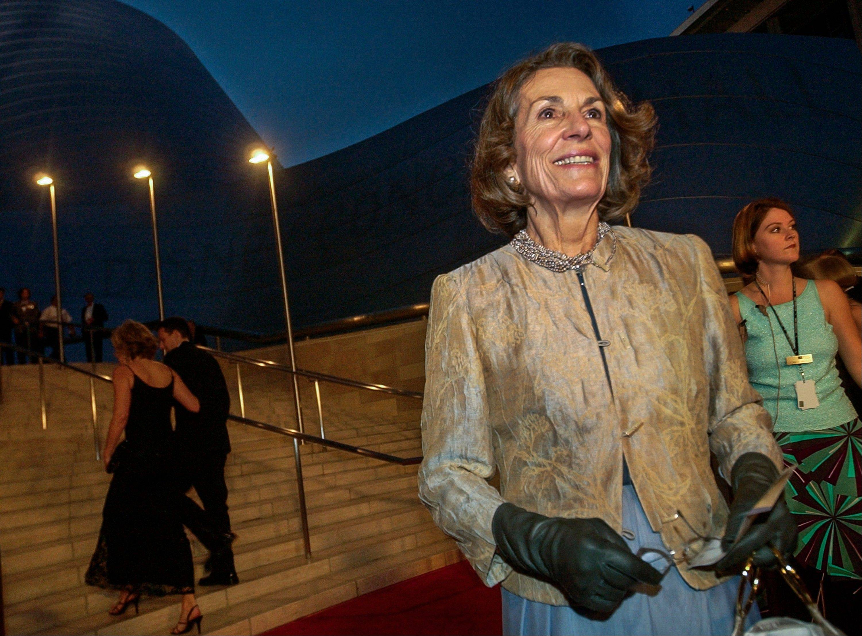 In this Oct. 23, 2003 file photo, Diane Disney Miller poses for photographers as she arrives for a grand opening concert gala at the new Walt Disney Concert Hall in Los Angeles. Disney Miller, the daughter of Walt Disney and one of his inspirations for building the Disneyland theme park, has died at her home in Napa, California. She was 79.