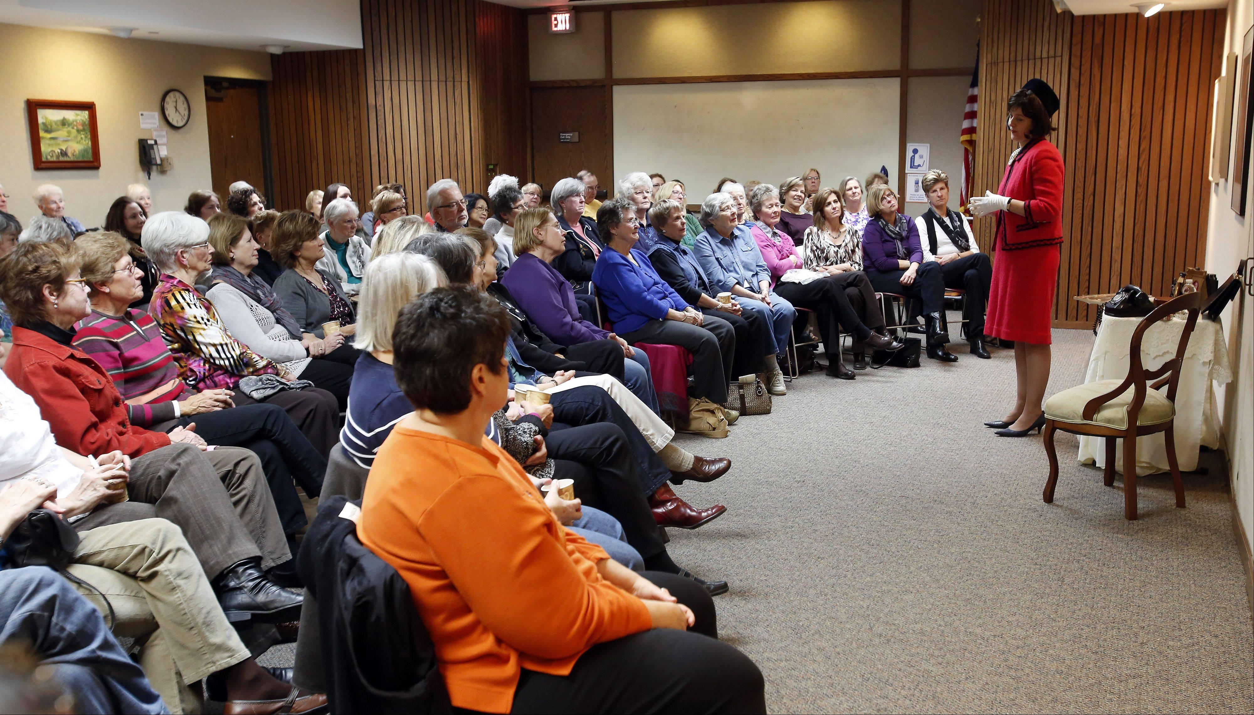 Actress and historian Leslie Goddard portrays Jacqueline Kennedy to a packed room at a special program commemorating the 50th anniversary of President John F. Kennedy´s death Tuesday in the Huntley Meeting Room at the St. Charles Public Library.