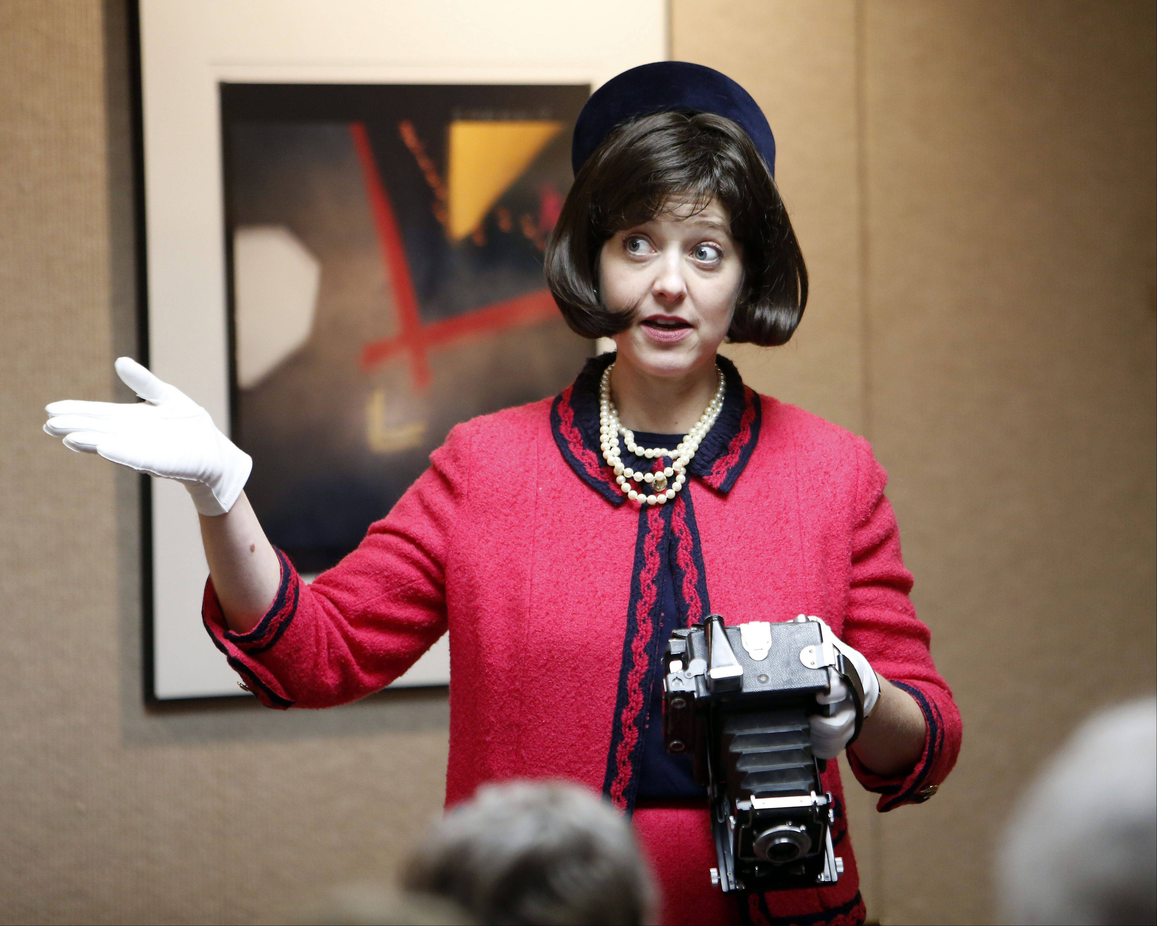 Actress and historian Leslie Goddard portrays Jacqueline Kennedy at a special program commemorating the 50th anniversary of President John F. Kennedy´s death Tuesday in the Huntley Meeting Room at the St. Charles Public Library.