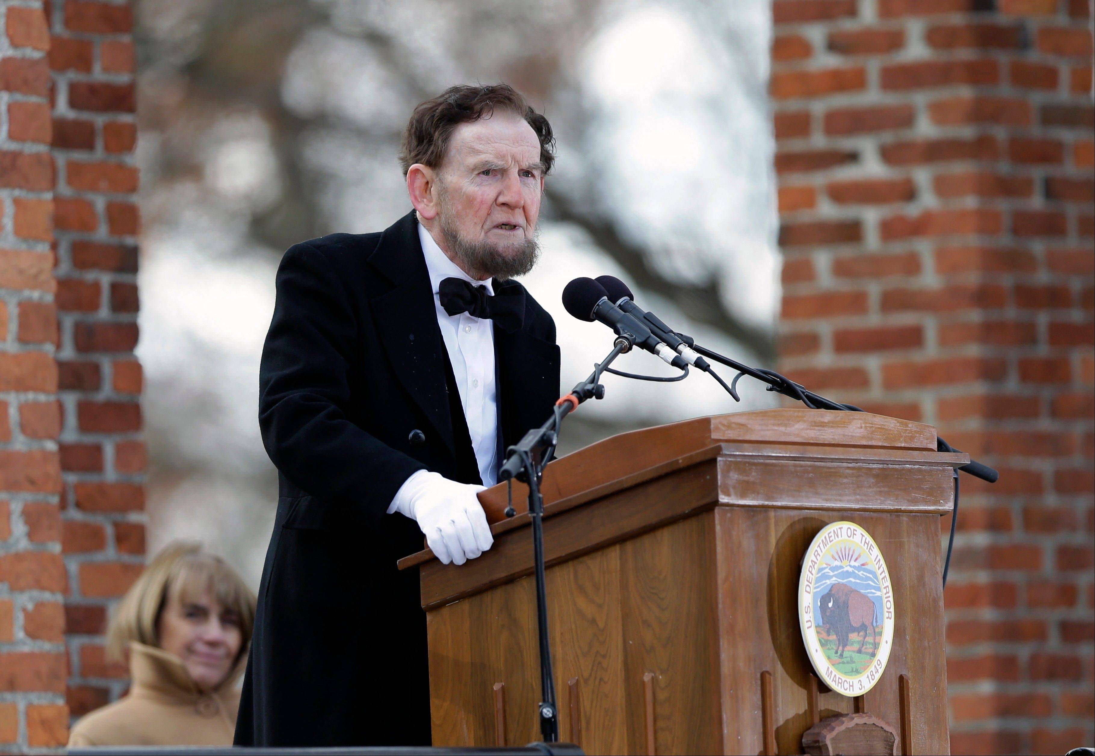 James Getty, portraying President Abraham Lincoln, recites the Gettysburg Address during a ceremony commemorating the 150th anniversary of the dedication of the Soldiers' National Cemetery and the historic speech, Tuesday Nov. 19, 2013, in Gettysburg, Pa.