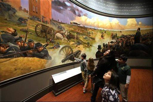 School groups and visitors view the Gettysburg Address and battle mural at the Abraham Lincoln Presidential Museum and Library in Springfield.