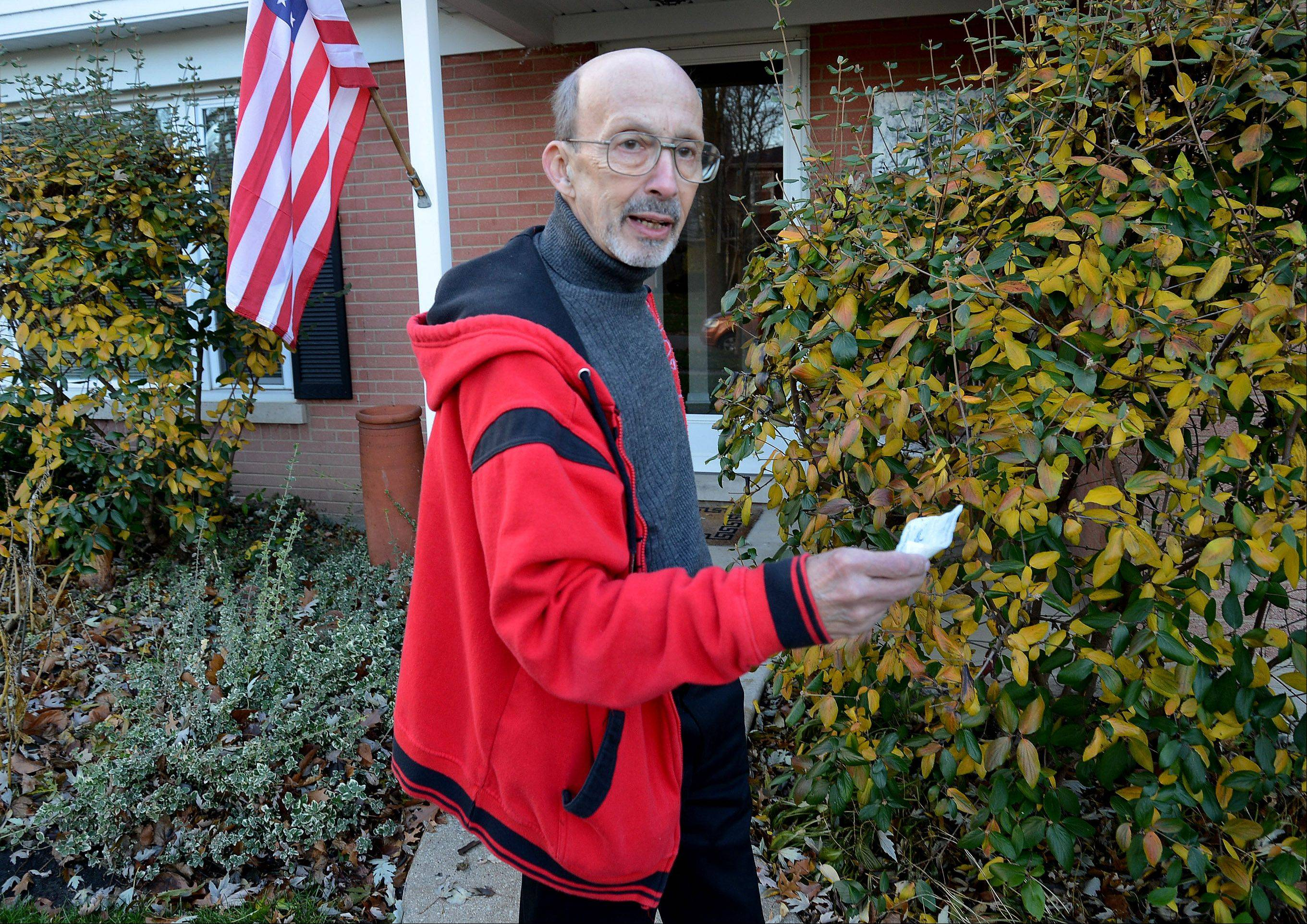 Lou Blanc of Arlington Heights said he's hoping to eventually connect with the Washington, Ill., resident whose personal check wound up in Blanc's front yard.
