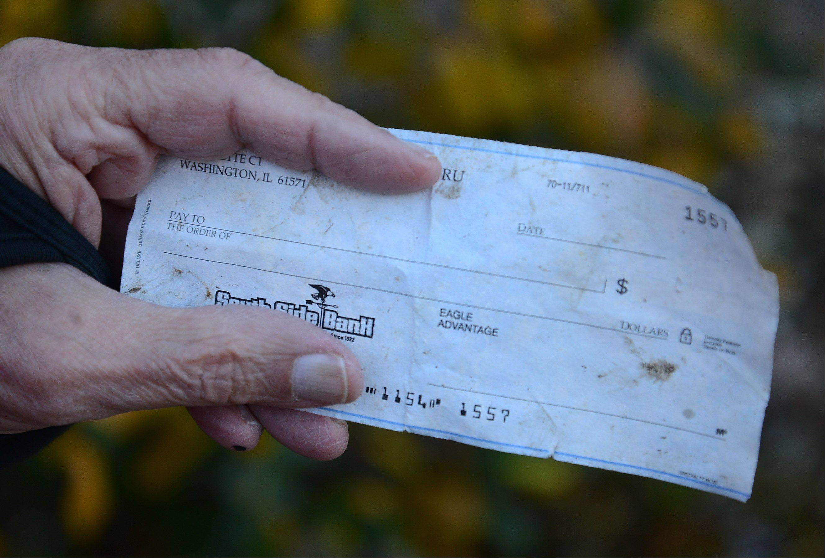 Lou Blanc of Arlington Heights found in his front yard a blank check from the city of Washington, Ill., the town devastated from Sunday's tornado.
