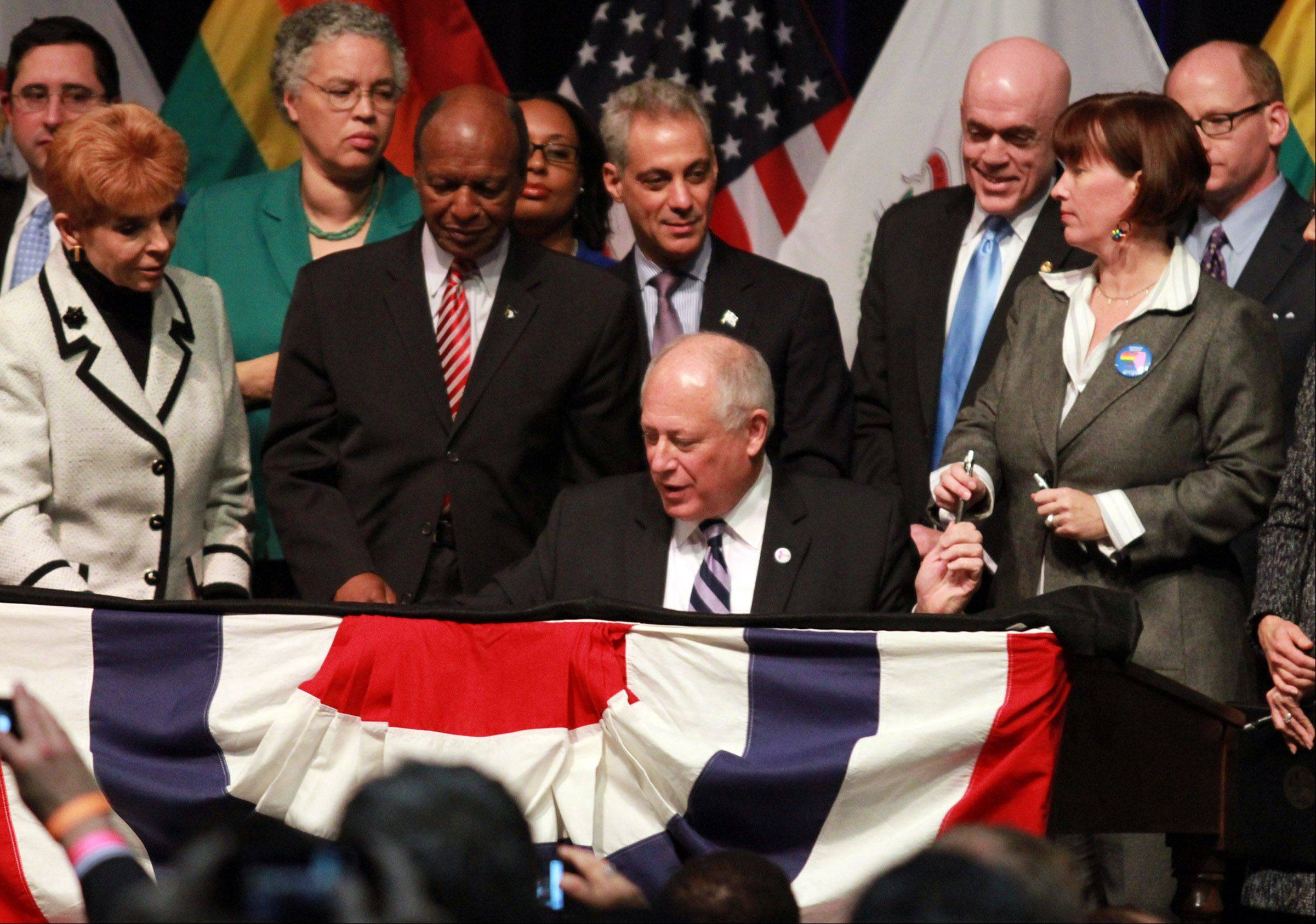 Gov. Pat Quinn on Wednesday signed into law a bill that legalizes same-sex marriage throughout Illinois. He used the same wooden desk on which Abraham Lincoln penned his first inaugural address during a ceremony at the University of Illinois at Chicago Forum.