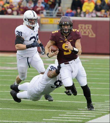 Minnesota quarterback Philip Nelson leaves behind Penn State defensive tackle Austin Johnson (99) and linebacker Ben Kline (38) during a Nov. 9 win in Minneapolis.