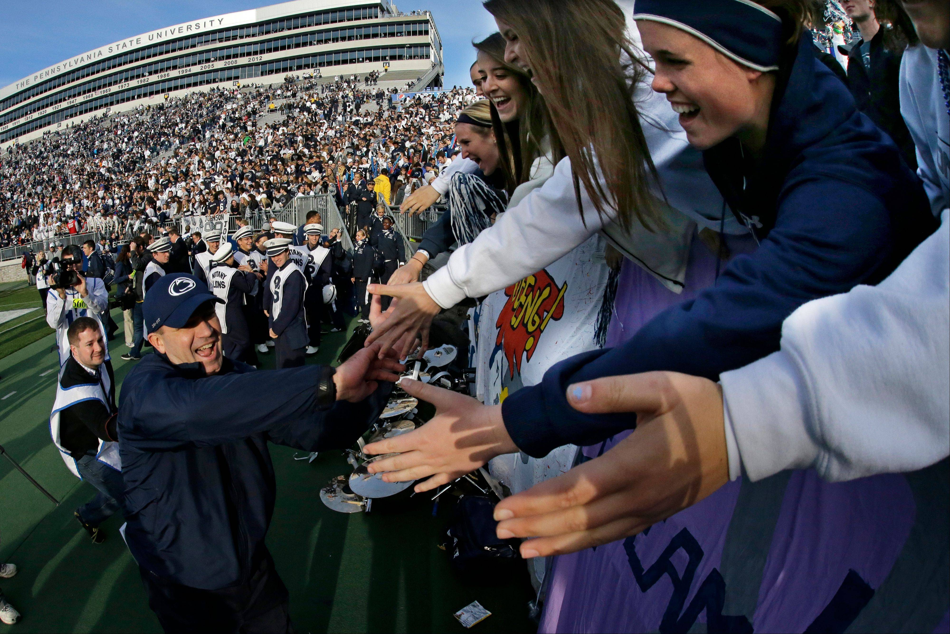 Penn State head football coach Bill O'Brien, left, celebrates with students after last Saturday's home win against Purdue.