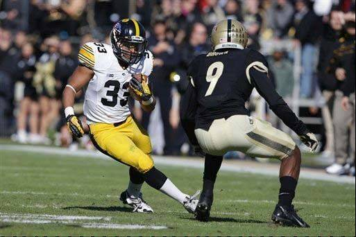 Iowa running back Jordan Canzeri, left, cuts in front of Purdue defensive back Anthony Brown during the first half of the Nov. 9 game in West Lafayette, Ind. Canzeri ran for 165 yards and a touchdown on 20 carries.