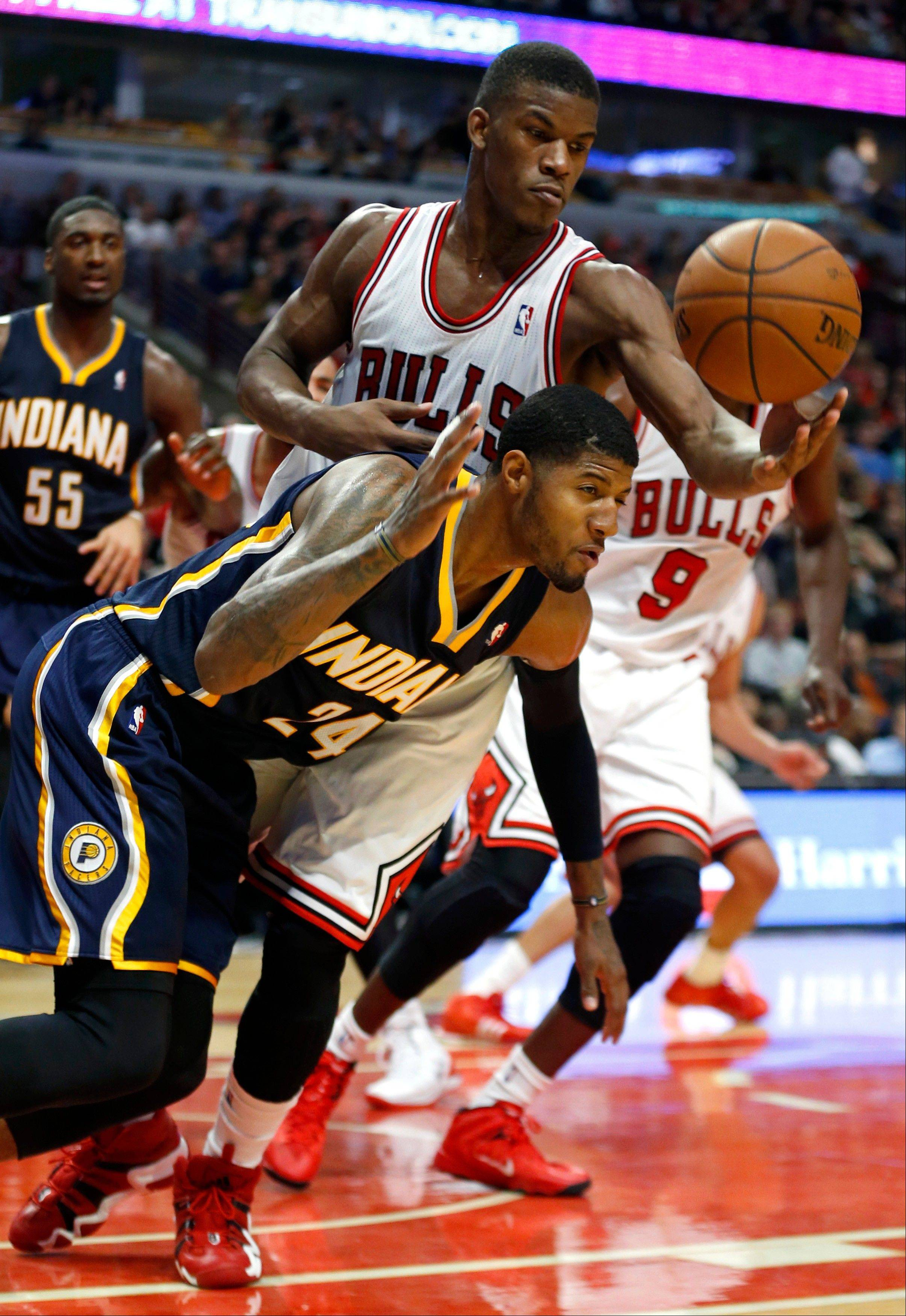 Indiana Pacers forward Paul George (24) vies for the ball with Bulls guard Jimmy Butler on Saturday. Butler injured a toe against Charlotte on Monday.