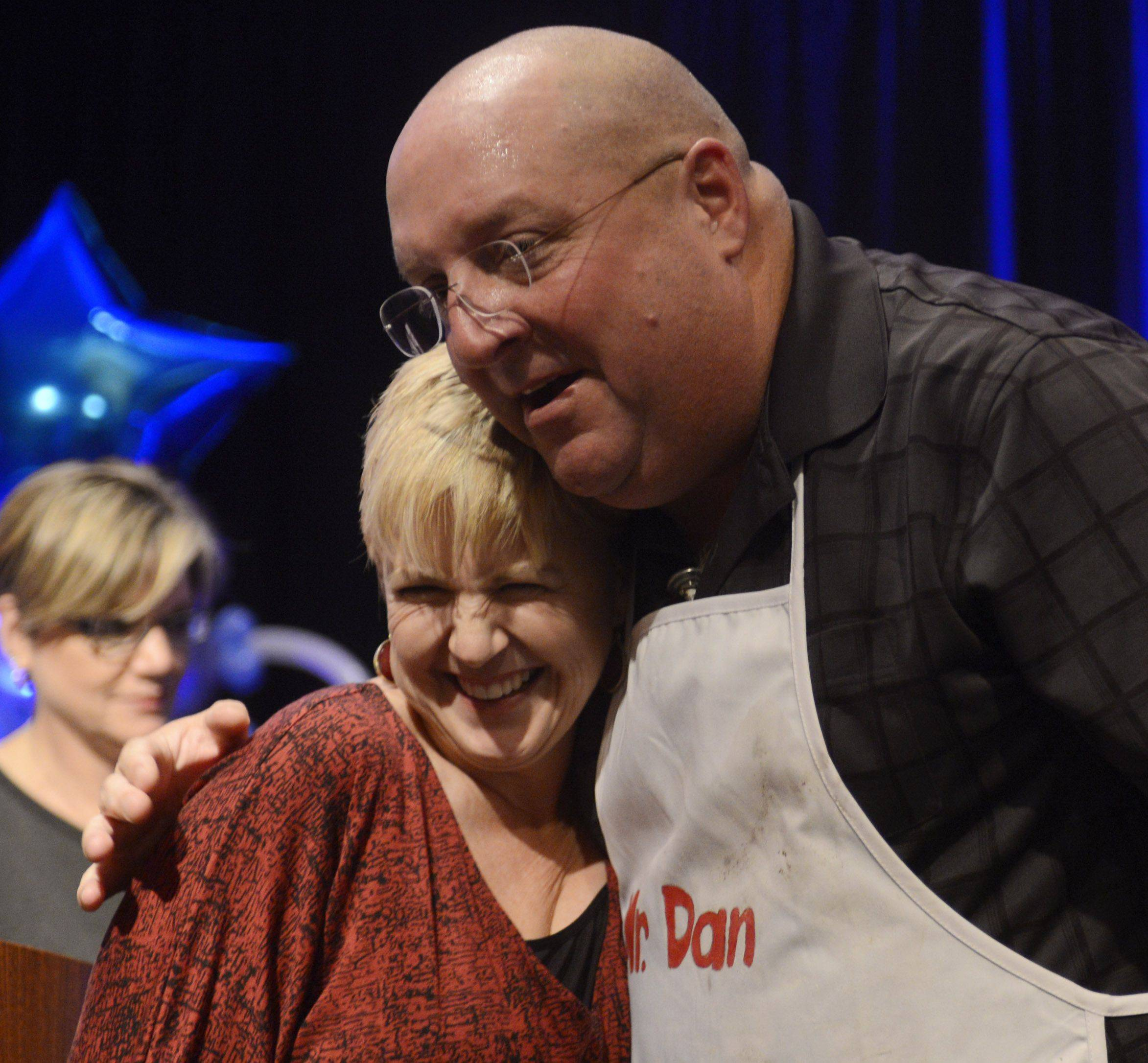 JOE LEWNARD/jlewnard@dailyherald.com Dan Rich of Elgin hugs Daily Herald Food Editor Deb Pankey after being announced the winner of the Daily Herald Cook of the Week Cookoff finals, held at the Hyatt Regency Schaumburg Wednesday.