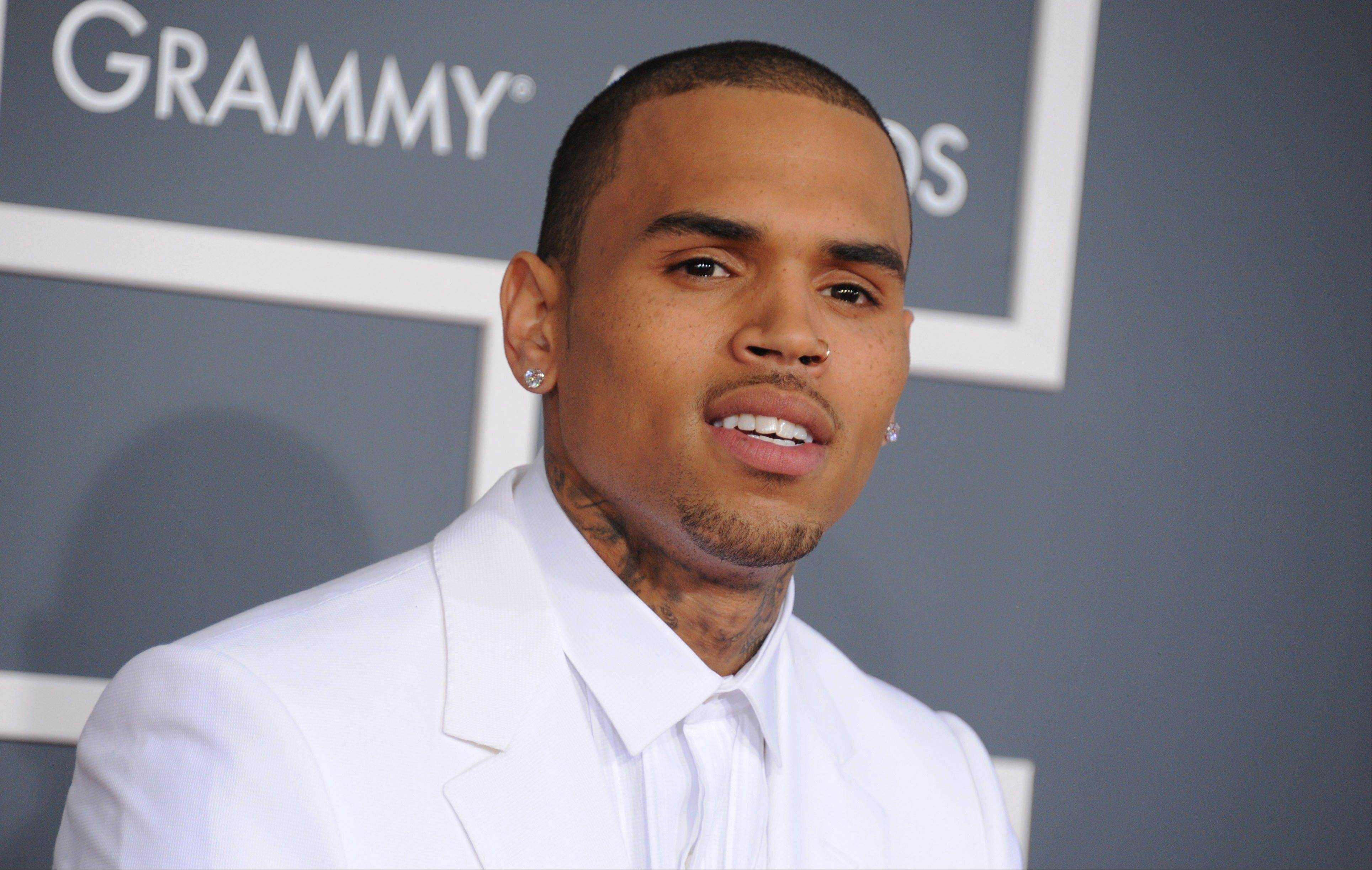 Chris Brown is due back in a Los Angeles courtroom on Wednesday, Nov. 20, 2013, to update a judge on his progress on completing community service ordered in an assault case filed after his 2009 attack on Rihanna. It will be Brown's first court appearance in LA since his arrest for misdemeanor assault in Washington, D.C.