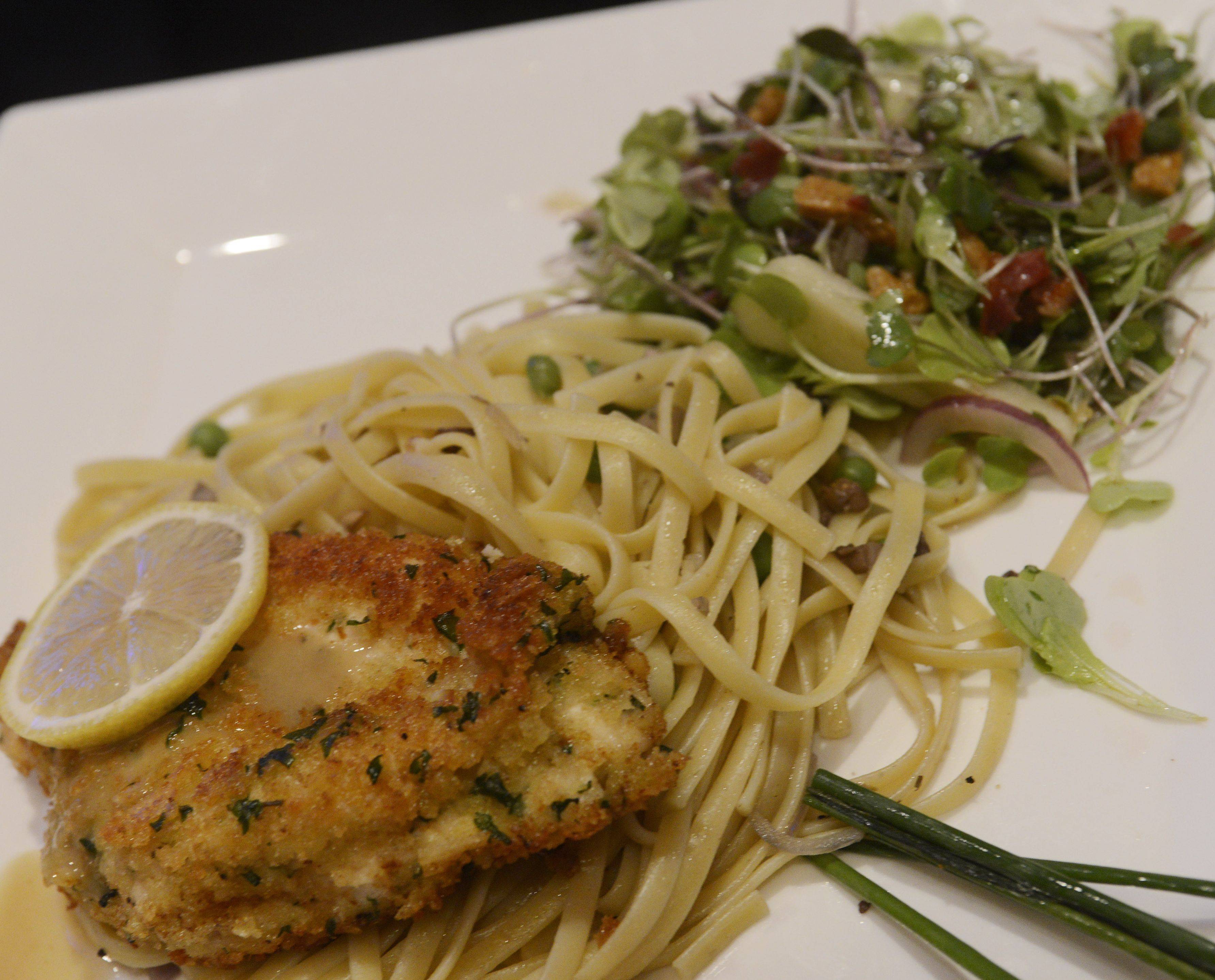 Lori Wiktorek plated Lemon Chicken Scallopini over Mushroom-Pea Pasta and Micro Green Salad during the Daily Herald Cook of the Week Cookoff finals.