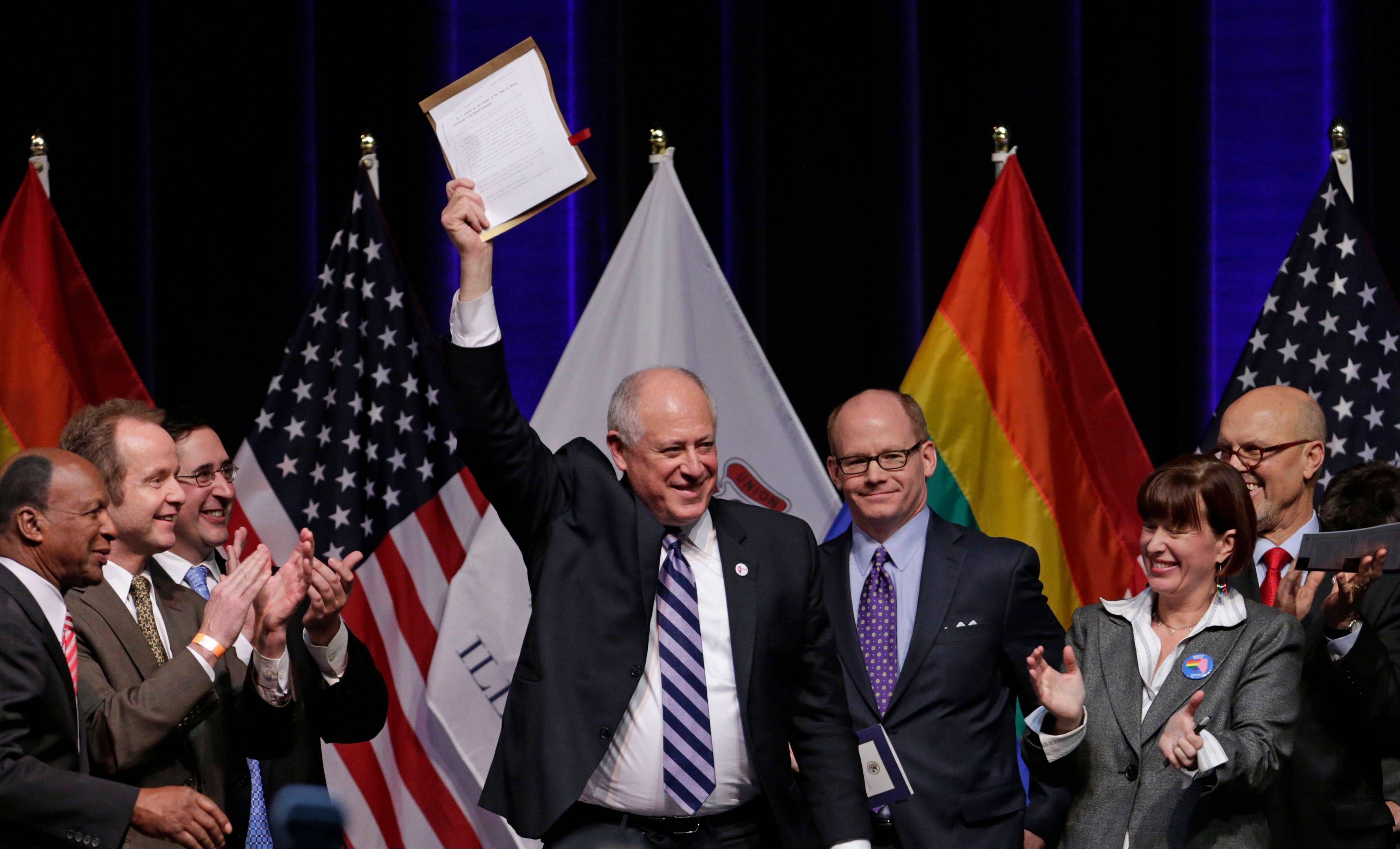 Illinois Gov. Pat Quinn acknowledges the applause after signing the Religious Freedom and Marriage Fairness Act into law, making Illinois the 16th state in the nation to embrace full marriage equality for same sex couples.
