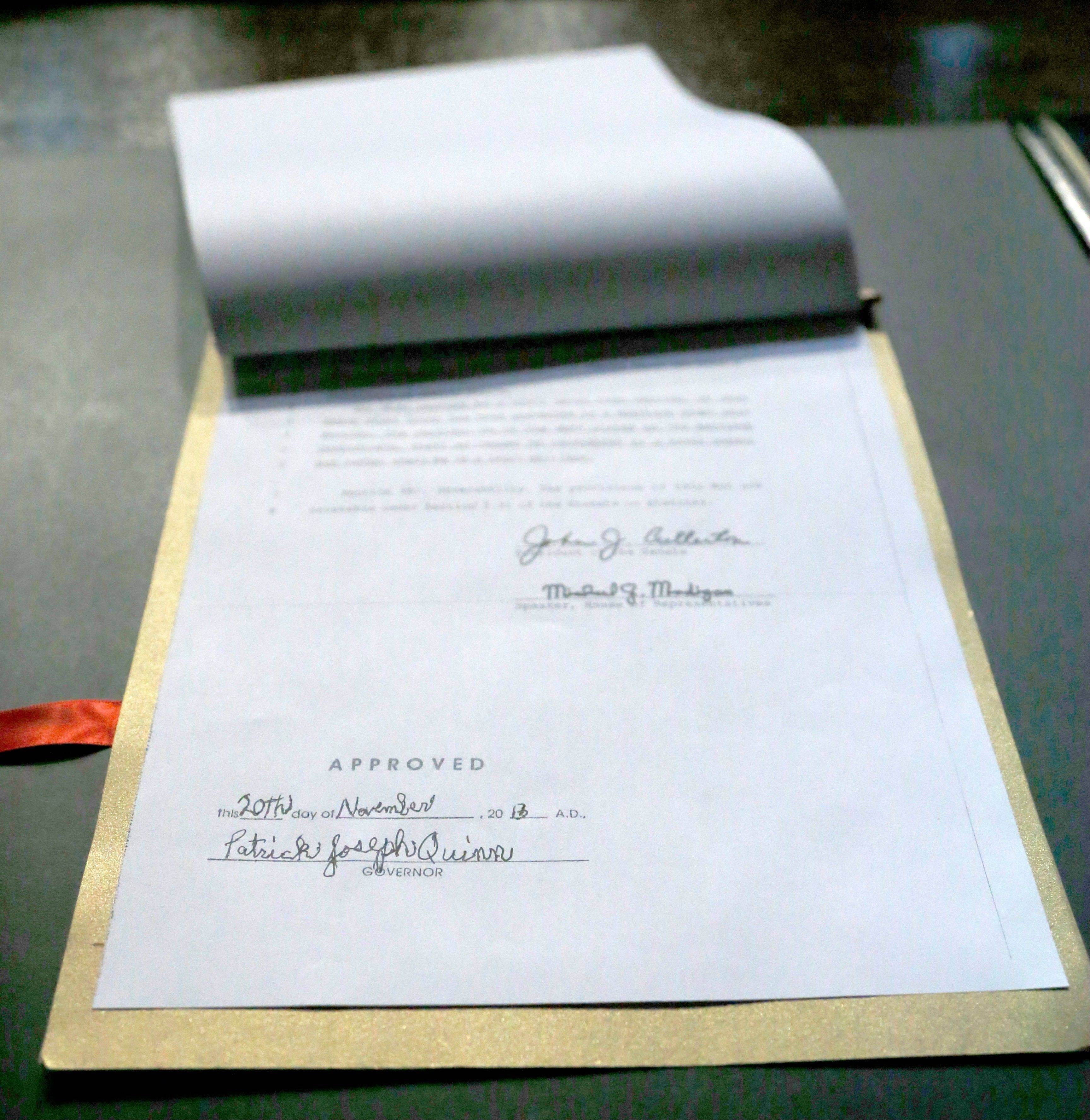 The signature of Illinois Gov. Patrick Joseph Quinn is affixed to the Religious Freedom and Marriage Fairness Act into law during ceremonies on the campus of the University of Illinois Chicago.