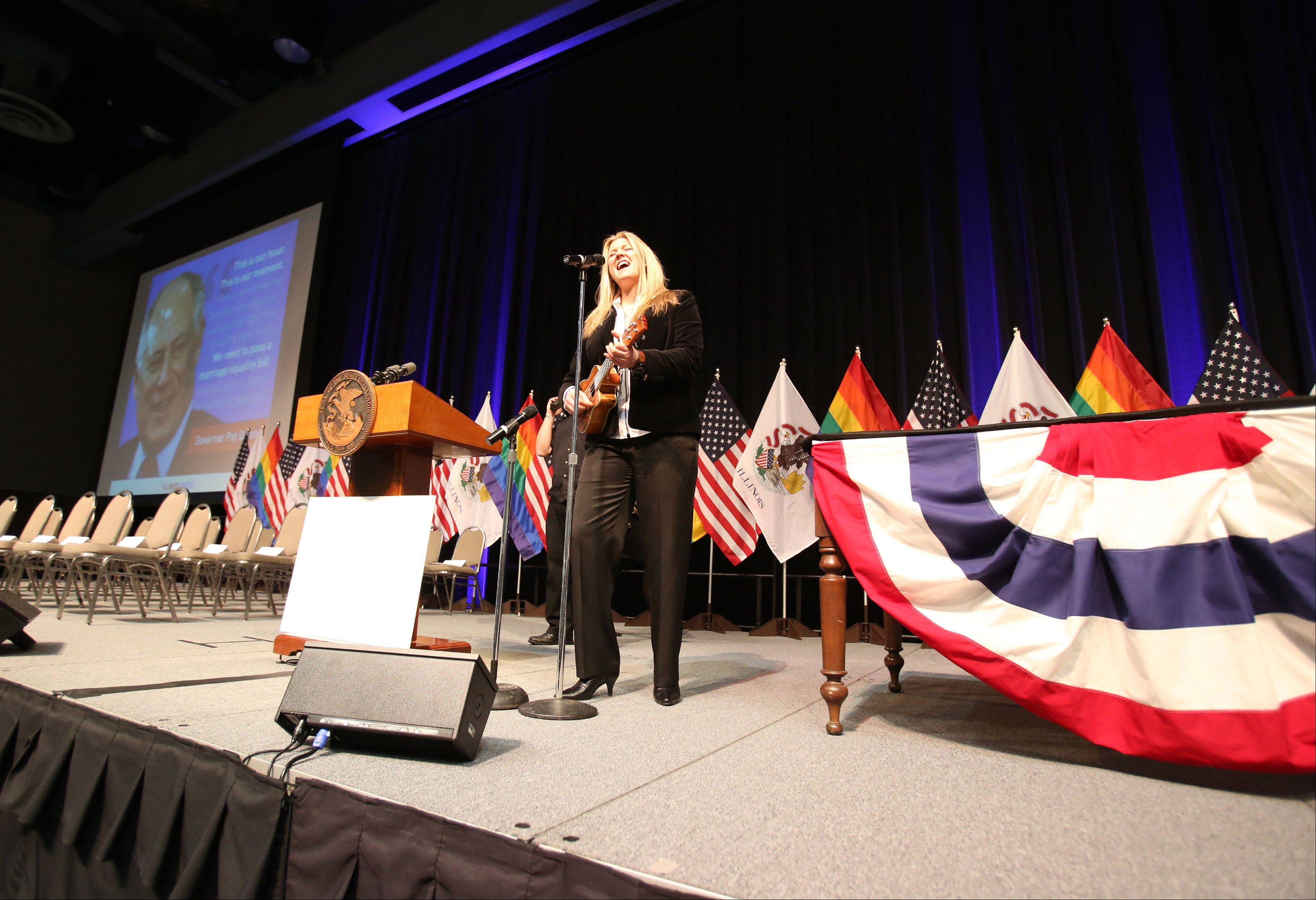 Sami Grisafe of Chicago rehearses the National Anthem which before performing at the start of the program.