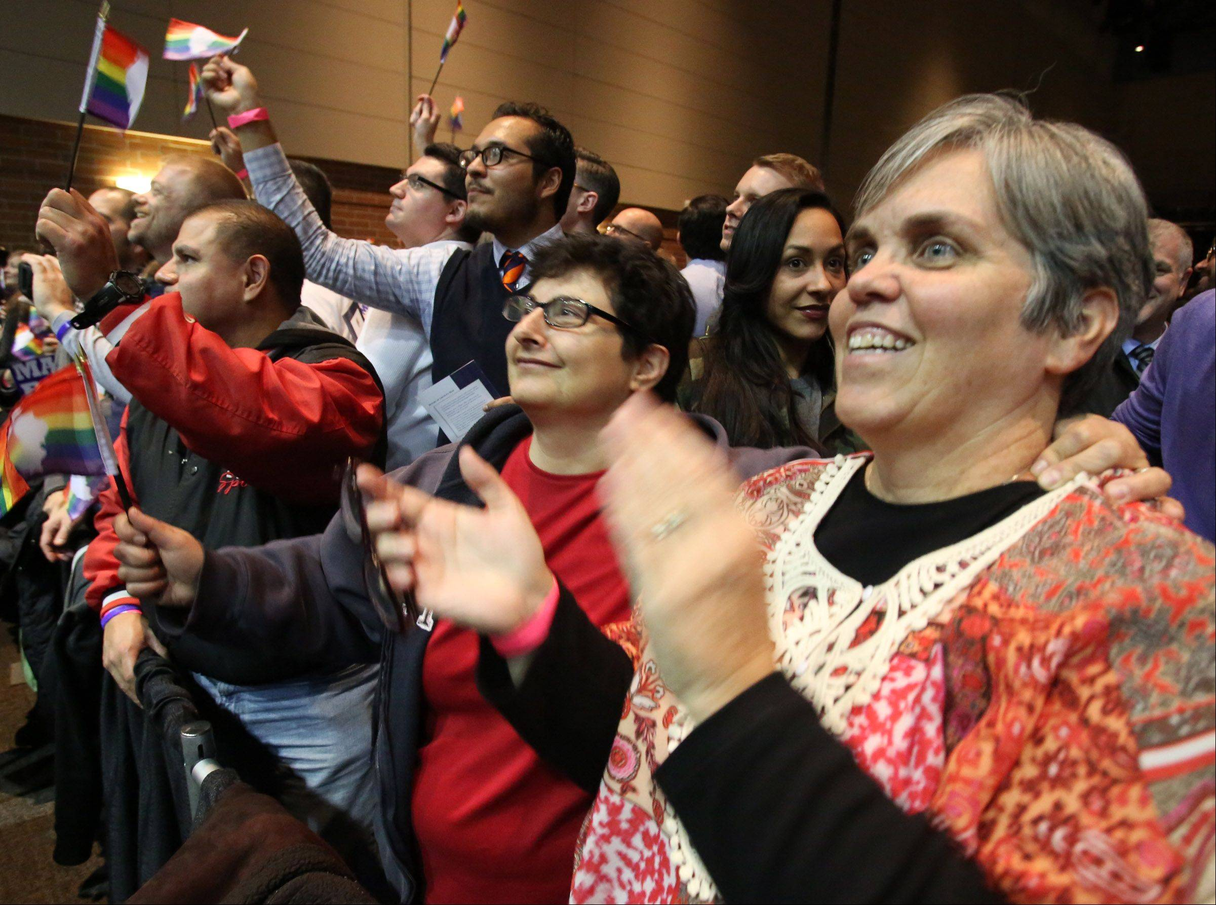 $PHOTOCREDIT_ON$George LeClaire/gleclaire@dailyherald.com$PHOTOCREDIT_OFF$Donna Corpolongo, left, and Geri Winters, both of Lombard, celebrate as Gov. Pat Quinn signs the Religious Freedom and Marriage Fairness Act.