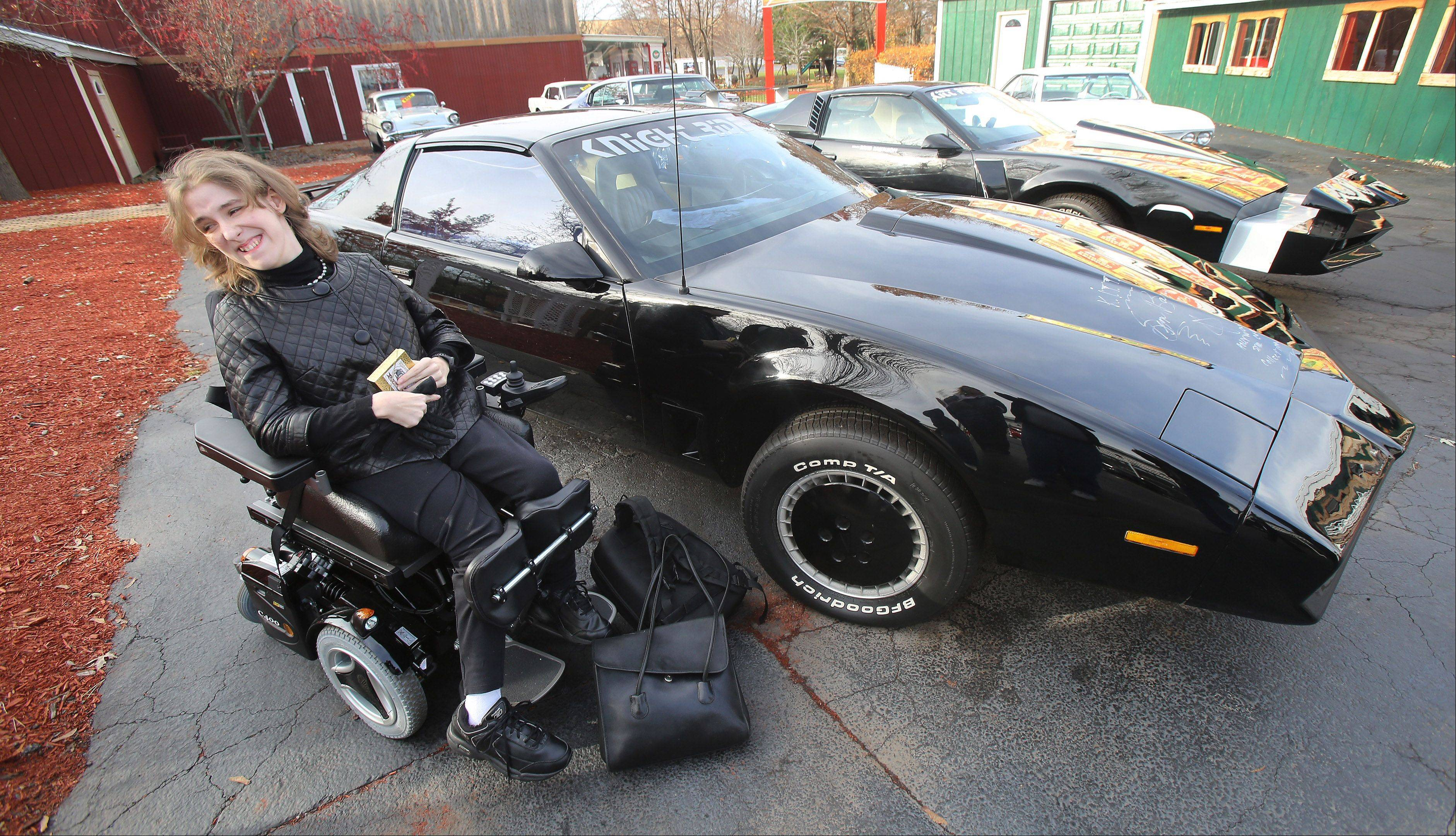 """Knight Rider"" fan Dawn Kennison of Wisconsin is delighted to see and ride in KITT, the car from the 1980s television show, at the Volo Auto Museum on Wednesday."