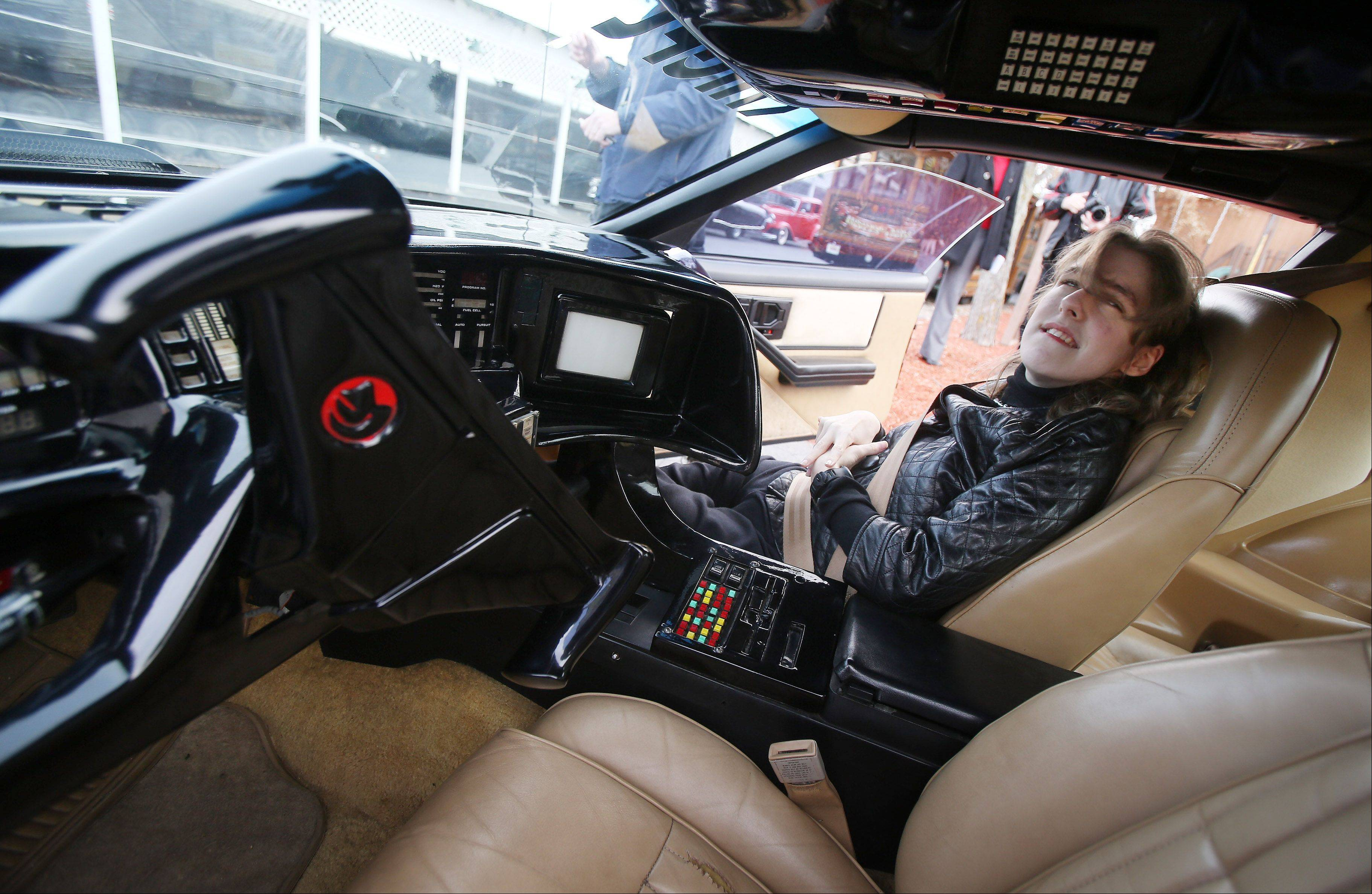 "Dawn Kennison of Wisconsin prepares for a ride in an exhibition model of KITT, the modified Trans Am made famous in the 1980s TV show ""Knight Rider"" at the Volo Auto Museum."