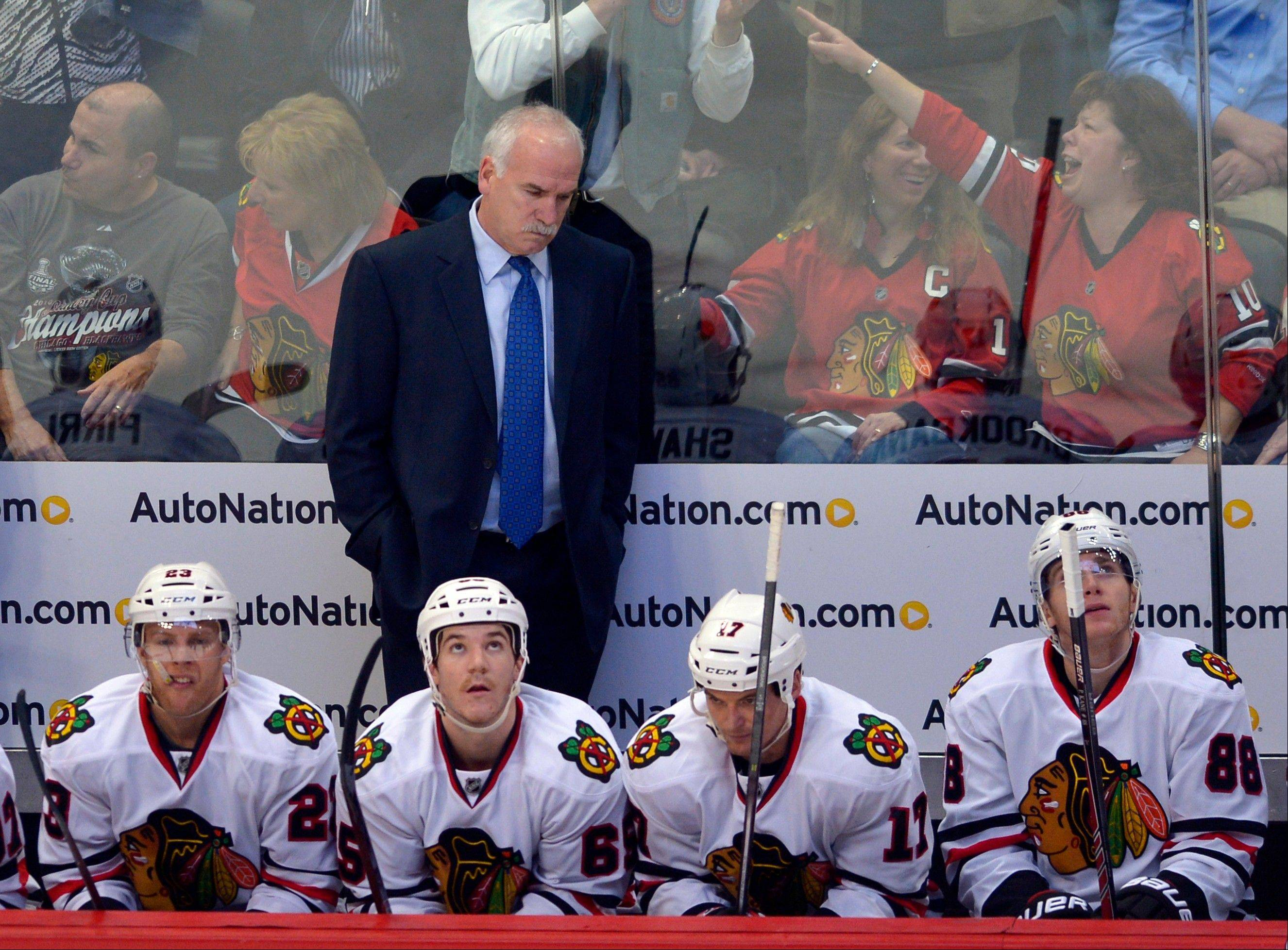 Blackhawks coach Joel Quenneville reacts to the Colorado Avalanche scoring a third goal during the first period of Tuesday night's 5-1 loss.