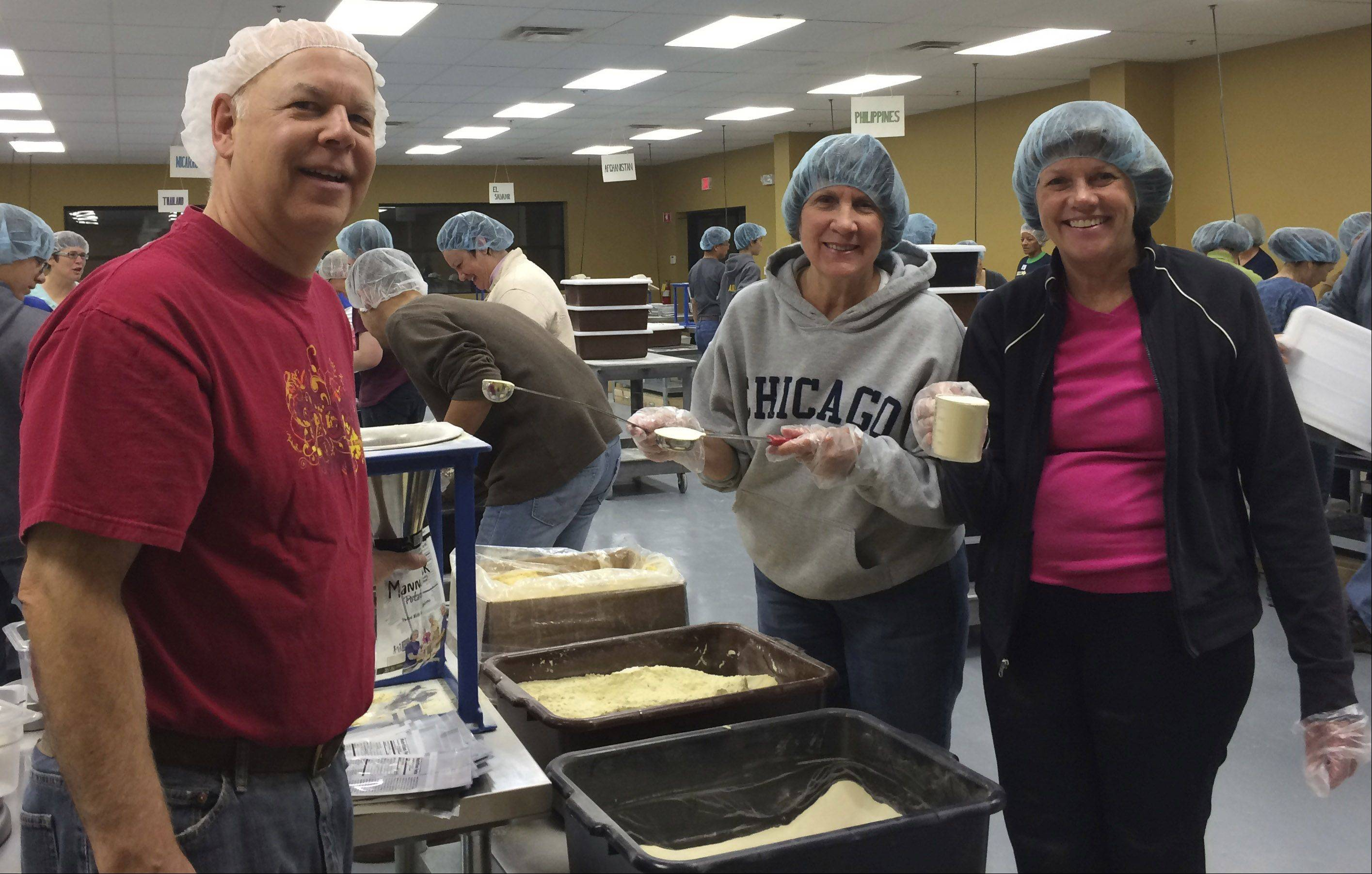 Jeff Whitehead, Nancy Prange and Kathy Whitehead at Libertyville's Feed My Starving Children.
