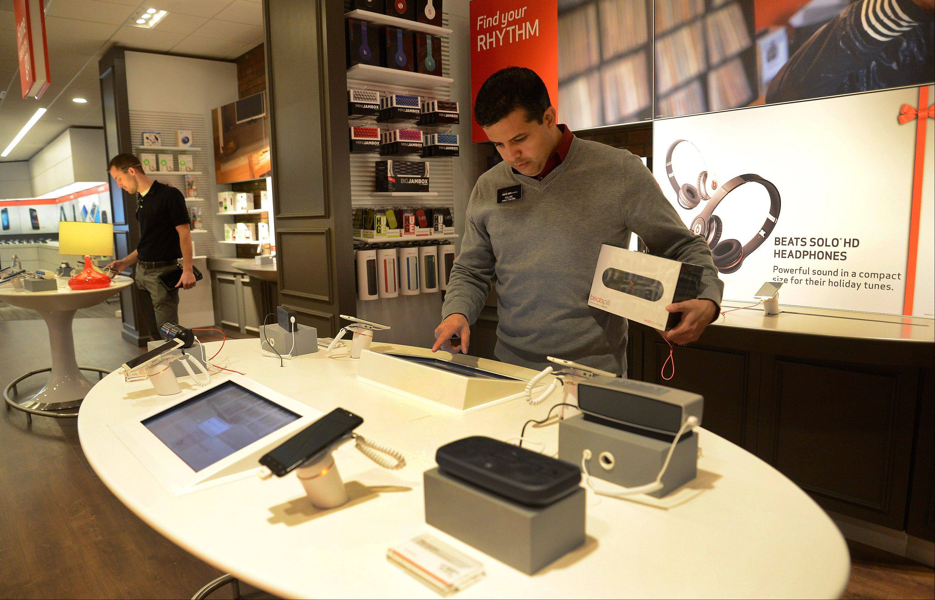 Solution Specialist Felipe Eguiguren demonstrates the Amplify It smart zone at Verizon Wireless' new Smart Store in Woodfield Mall.