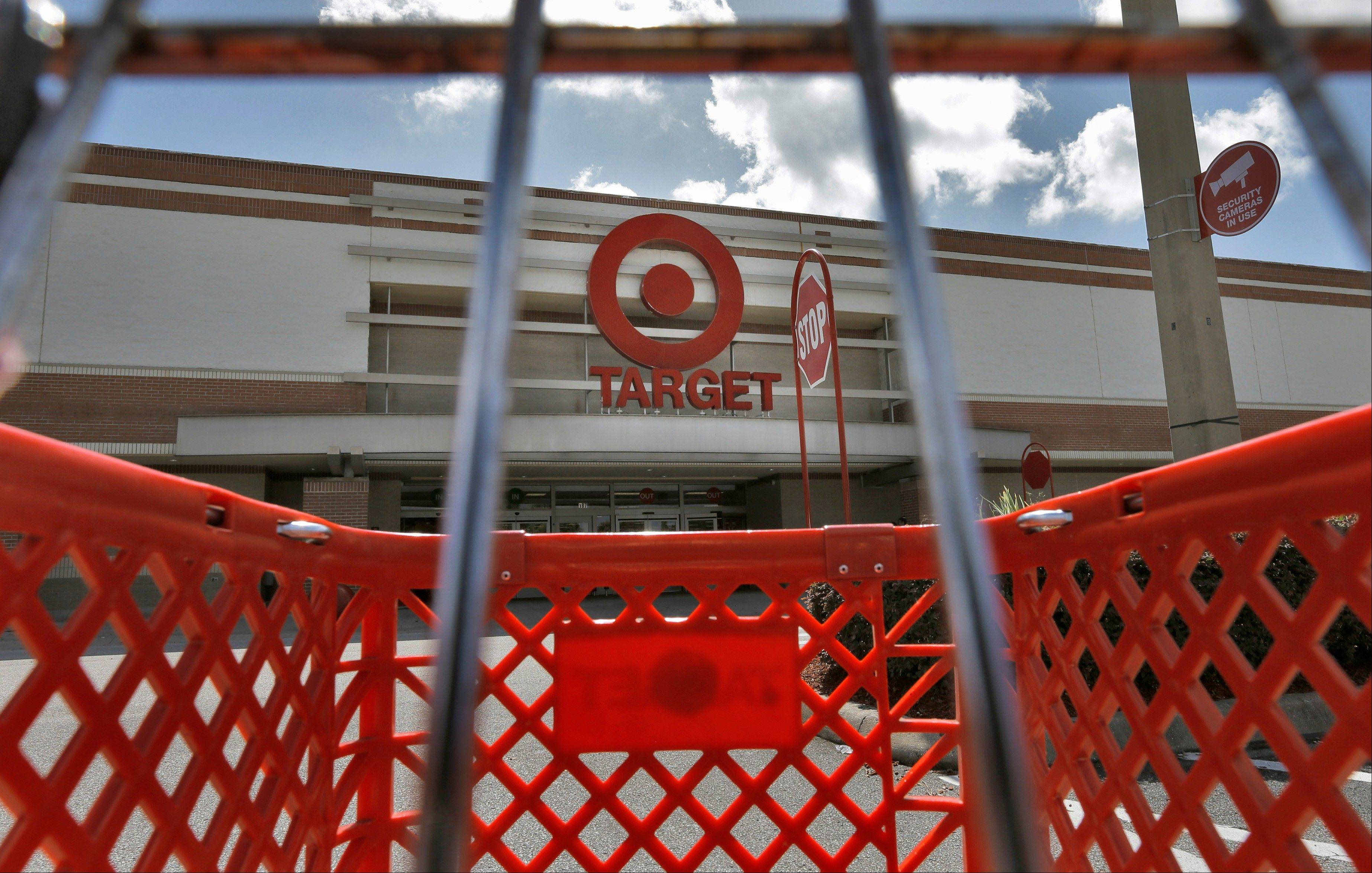 Target's third-quarter net income dropped 47 percent, stung by costs related to its expansion into Canada. The discount store operator's adjusted profit beat analysts' estimates, but revenue fell short.
