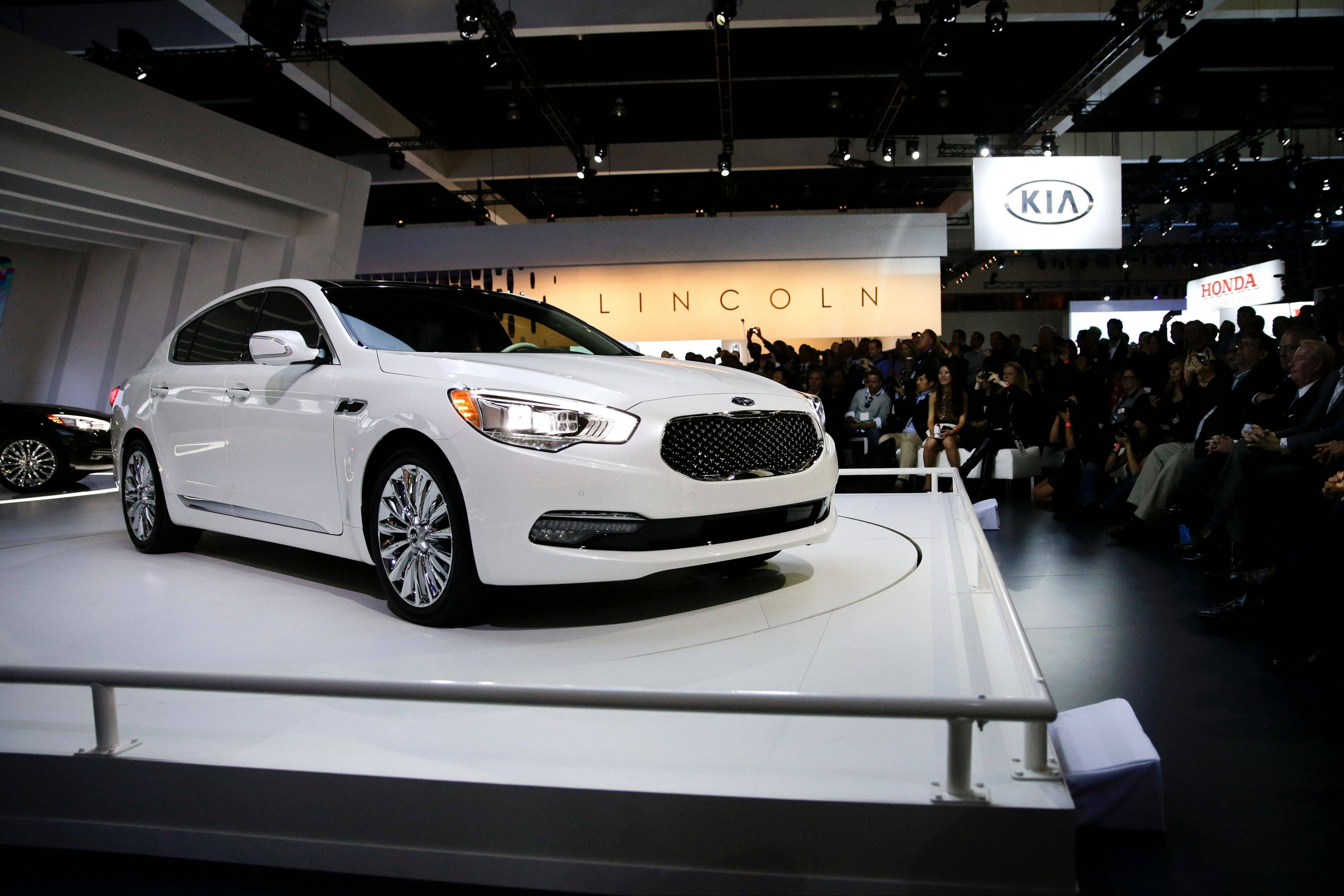 The new 2015 Kia K900 is introduced at the Los Angeles Auto Show on Wednesday in Los Angeles. Kia Motors Corp. is recalling nearly 80,000 minivans in the U.S. because a suspension part can break and cause drivers to lose control of the vehicles.