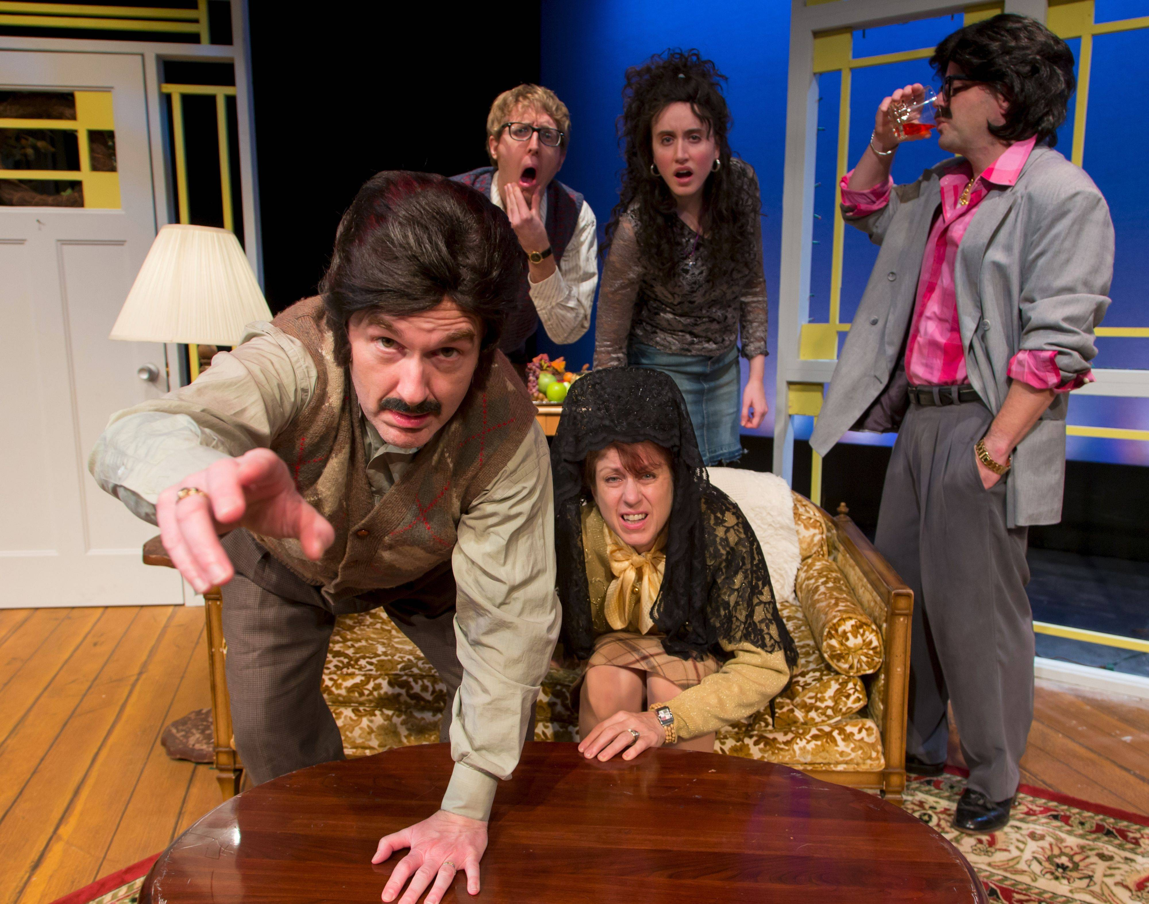 "The annual family photograph goes awry in Fox Valley Repertory's ""Making God Laugh,"" starring clockwise from bottom left: Michael Joseph Mitchell, Jesse Dornan, Christina Gorman, Tom Moore and Caron Buinis."
