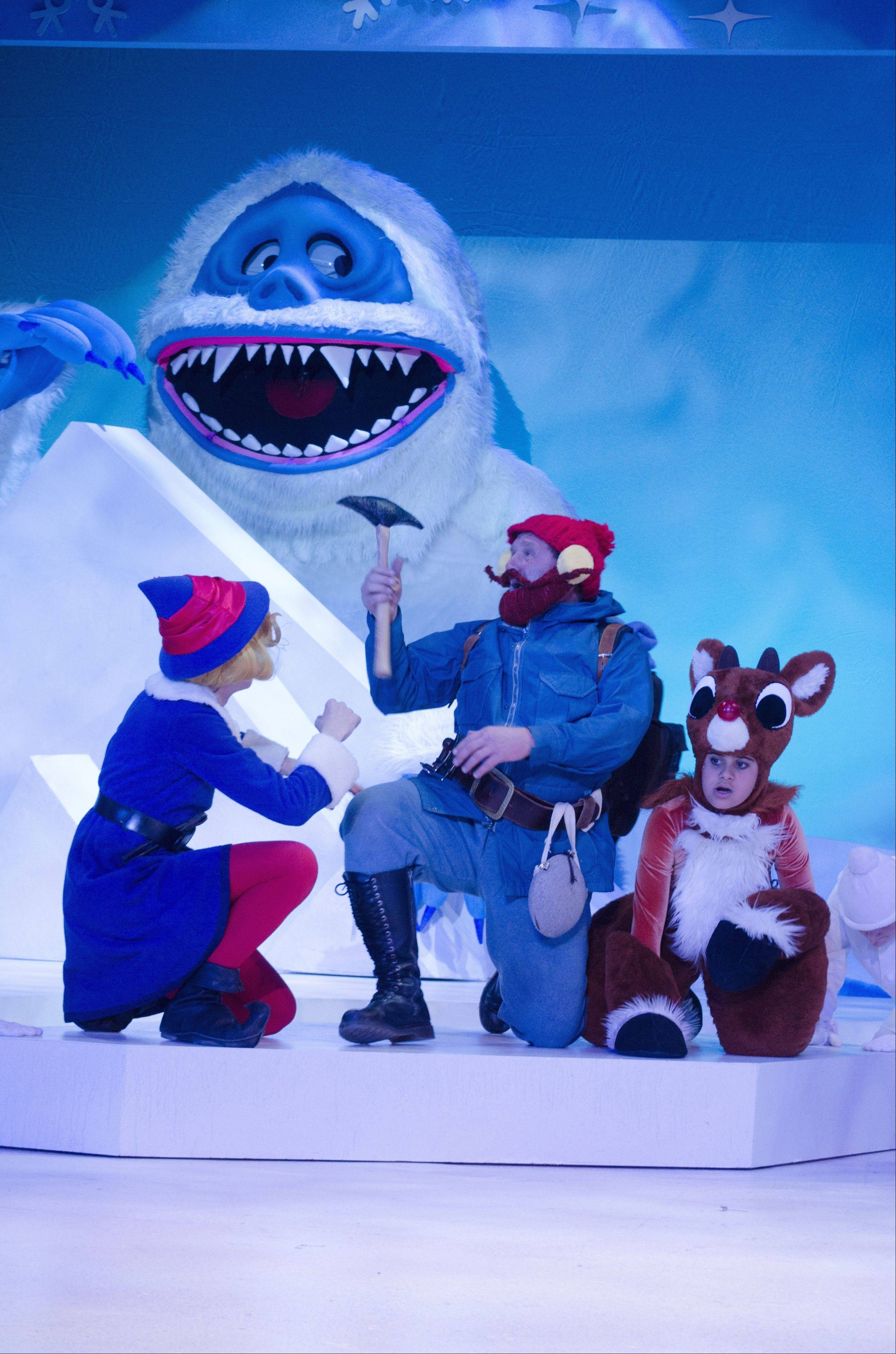 Hermey the Elf (Glenbard West High School sophomore Michael Saguto), Yukon Cornelius (Michael Accardo) and Rudolph (Cody J. Bolithon) try to escape the Abominable Snow Monster.
