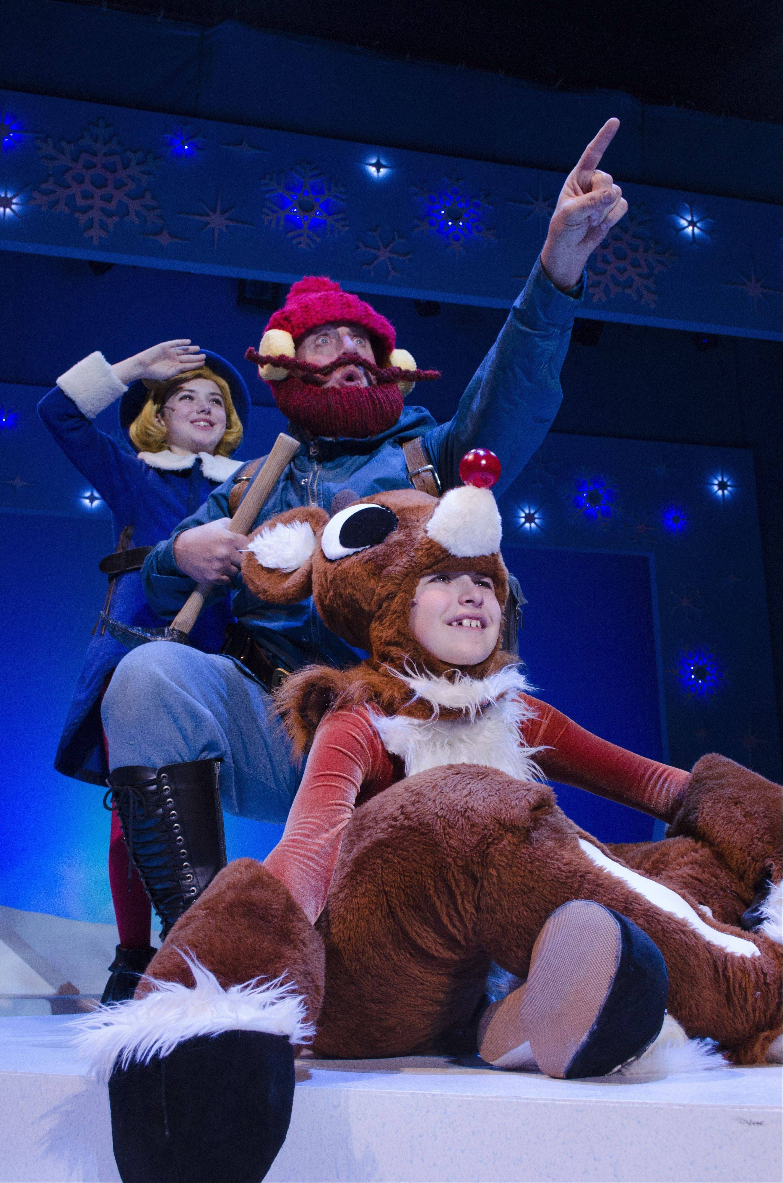 "Hermey the Elf (Glenbard West High School sophomore Michael Saguto), Yukon Cornelius (Michael Accardo) and Rudolph (Cody J. Bolithon) head toward the Island of Misfit Toys in ""Rudolph the Red-Nosed Reindeer: The Musical."""
