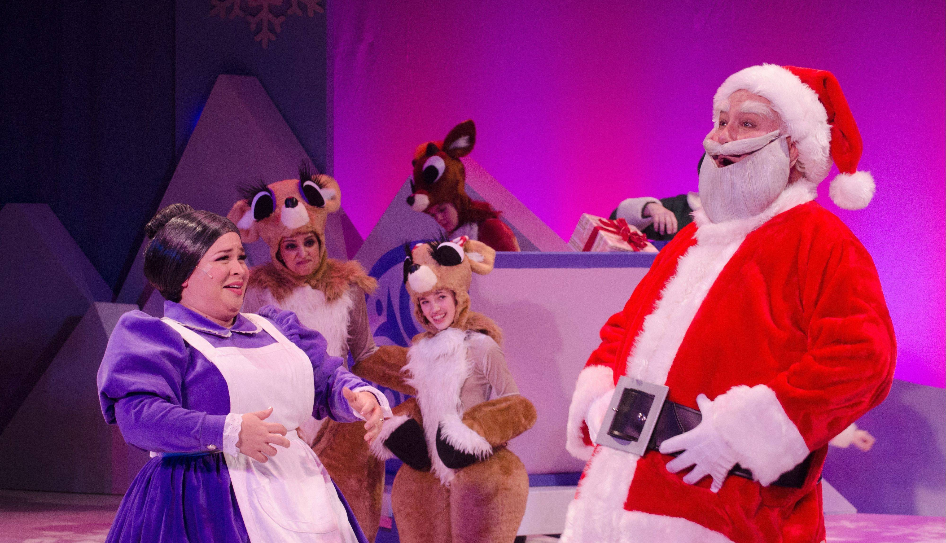 "Mrs. Claus (Lillian Castillo) and Santa (Robb Alton) share a joyful moment in ""Rudolph the Red-Nosed Reindeer: The Musical."""
