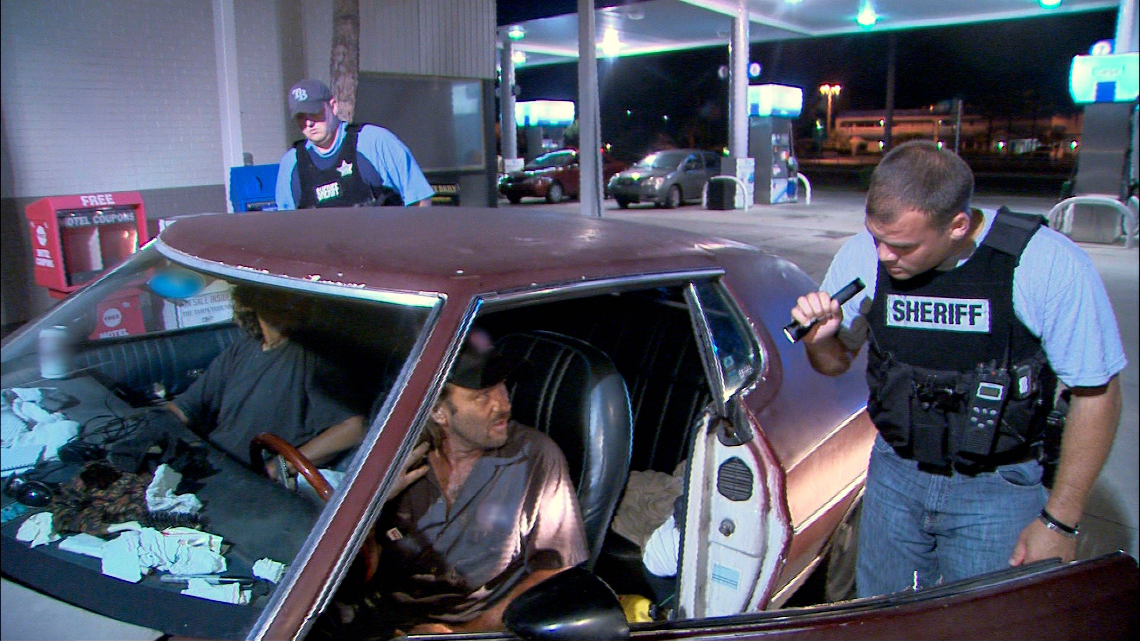 "Police officers in Hillsborough, Fla., interrogate two occupants of a car for suspicious drug activity in an episode of ""Cops."" The documentary-style crime series has found the freedom to be edgier since moving to cable."